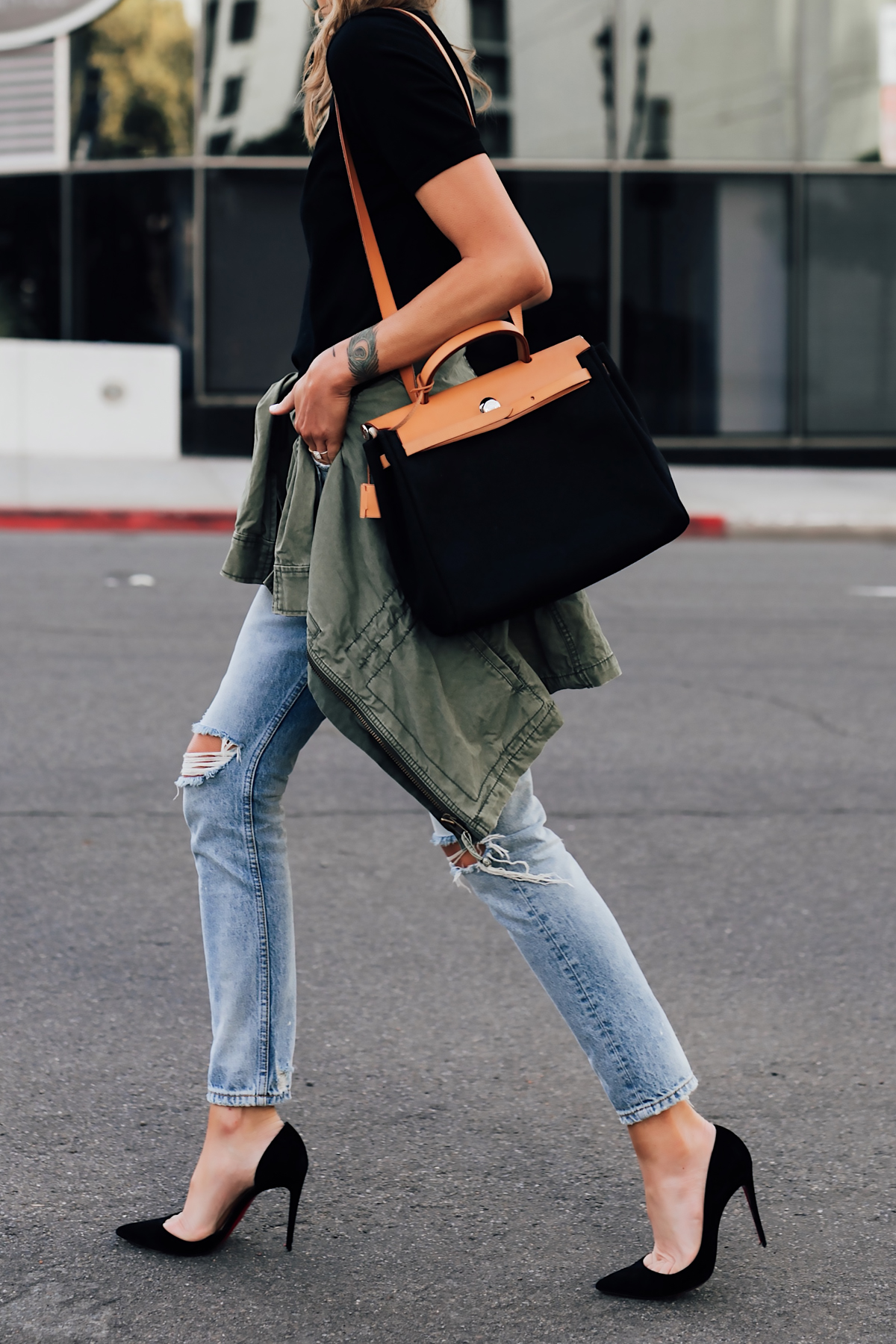 Woman Wearing Short Sleeve Black Top Denim Ripped Skinny Jeans Black Pumps Green Utility Jacket Vintage Hermes Herbag Black Tan Handbag Fashion Jackson San Diego Fashion Blogger Street Style