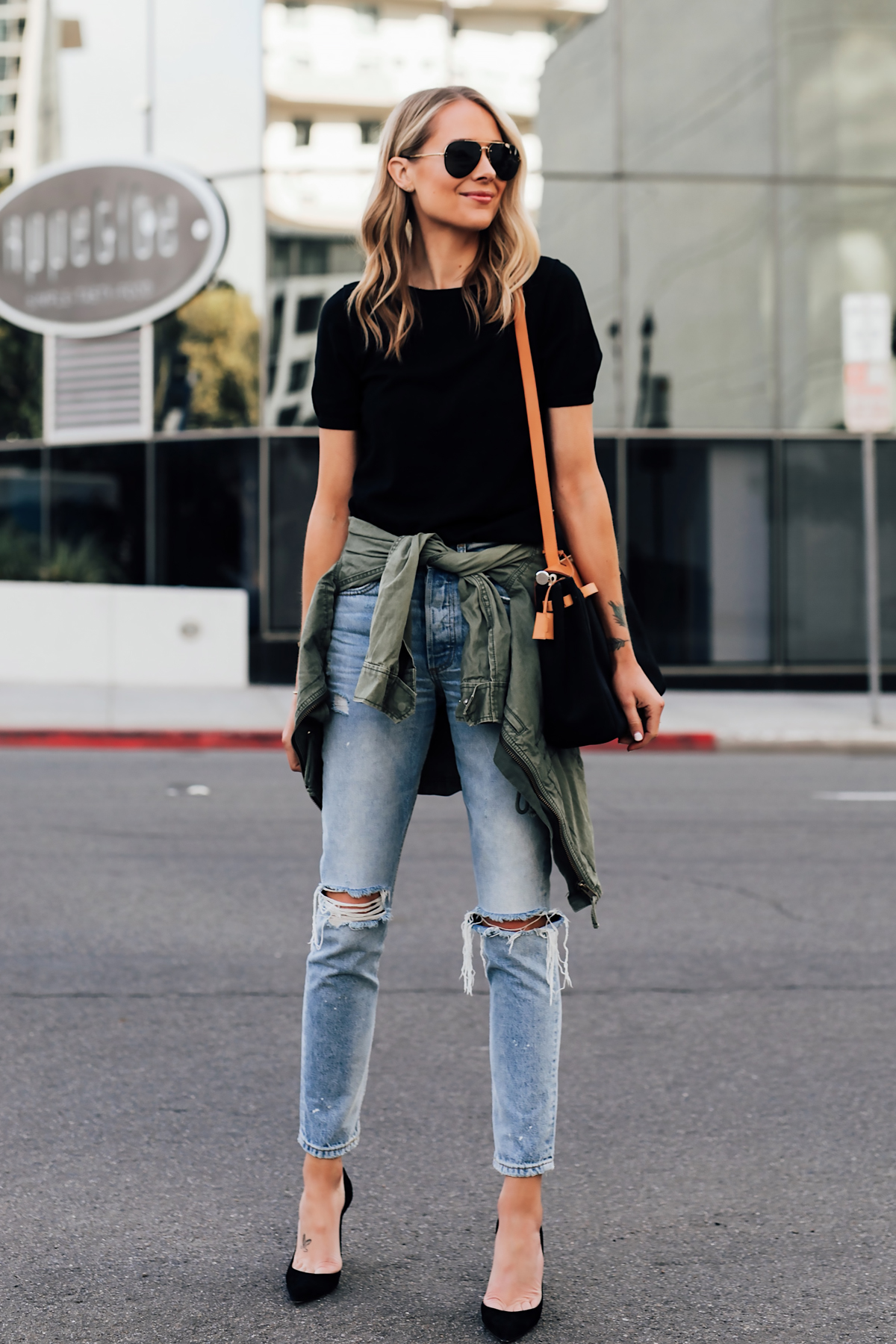 Blonde Woman Wearing Short Sleeve Black Top Denim Ripped Skinny Jeans Black Pumps Green Utility Jacket Fashion Jackson San Diego Fashion Blogger Street Style