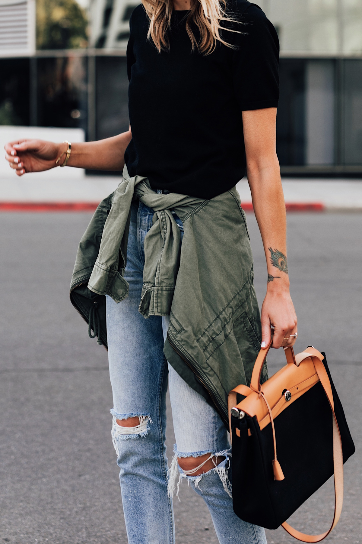 95c0f59a2 Woman Wearing Fashion Jackson Wearing Short Sleeve Black Top Denim Ripped  Skinny Jeans Green Utility Jacket