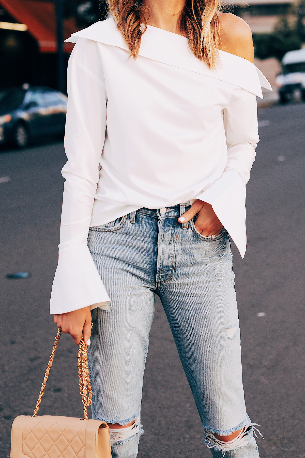 Blonde Woman Wearing White Off the Shoulder Top Ripped Jeans Tan Handbag Fashion Jackson San Diego Fashion Blogger Street Style