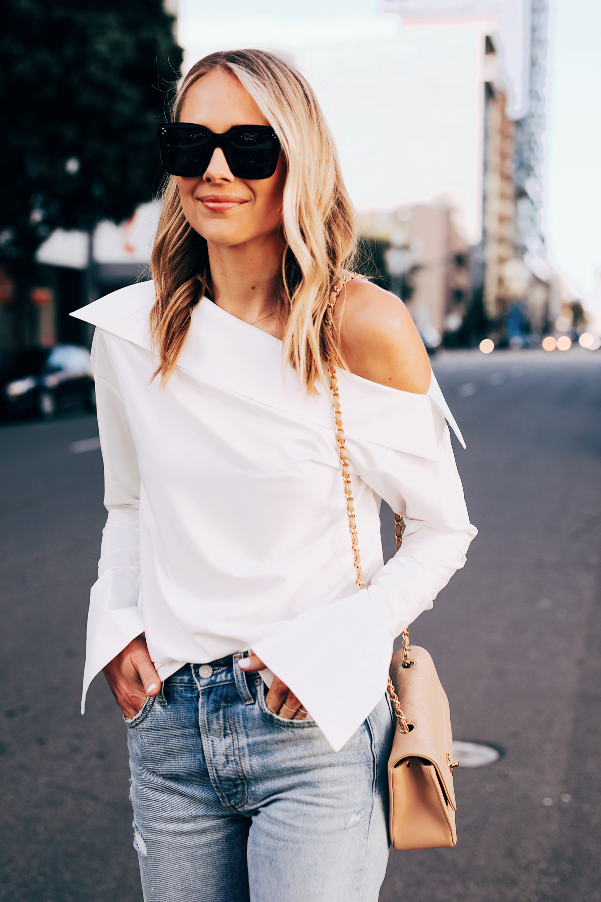 Blonde Woman Wearing White Off the Shoulder Top Ripped Jeans Fashion Jackson San Diego Fashion Blogger Street Style
