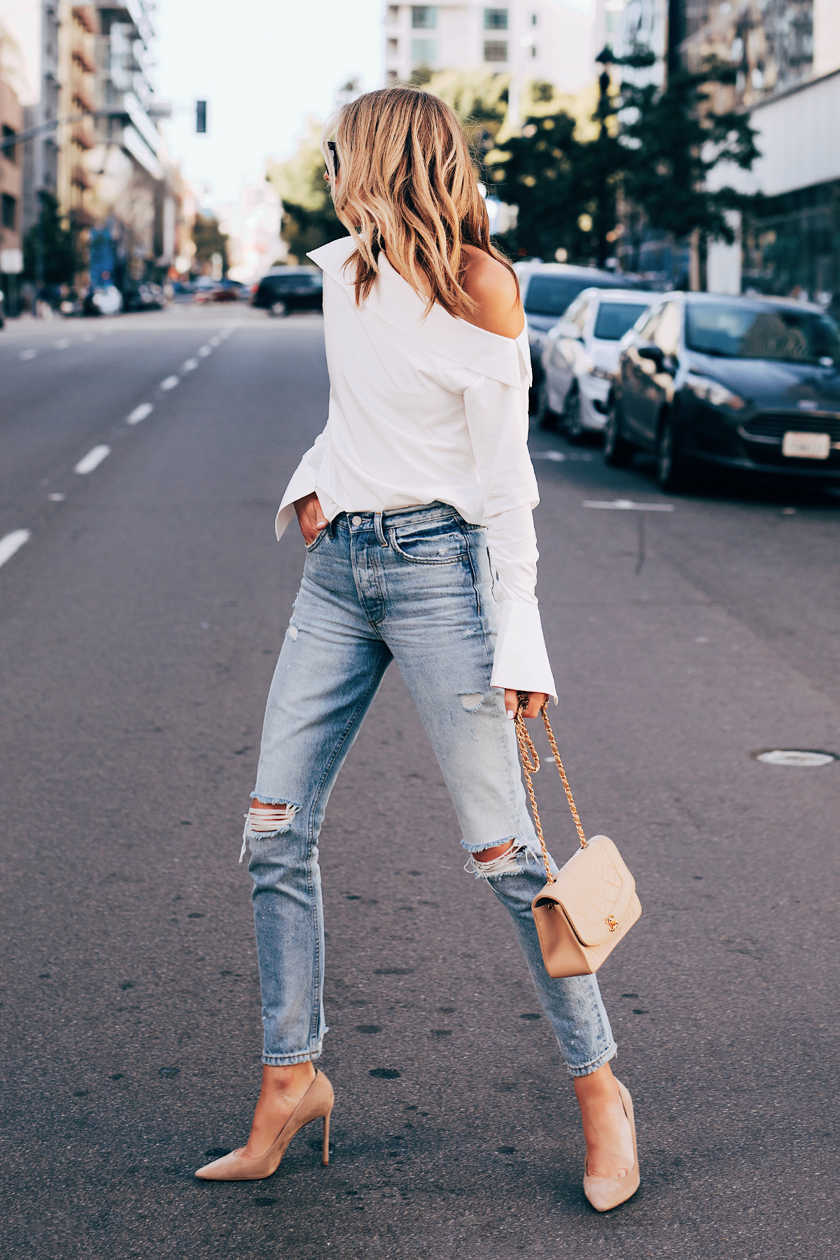 Blonde Woman Wearing White off the Shoulder Top Denim Ripped Jeans Nude Pumps Tan Handbag Fashion Jackson San Diego Fashion Blogger Street Style