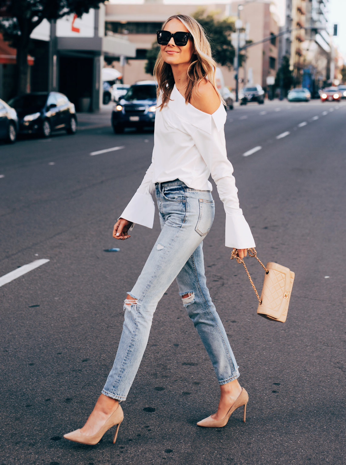 Fashion Jackson Wearing White off the Shoulder Top Denim Ripped Jeans Nude Pumps Tan Handbag Featured Image
