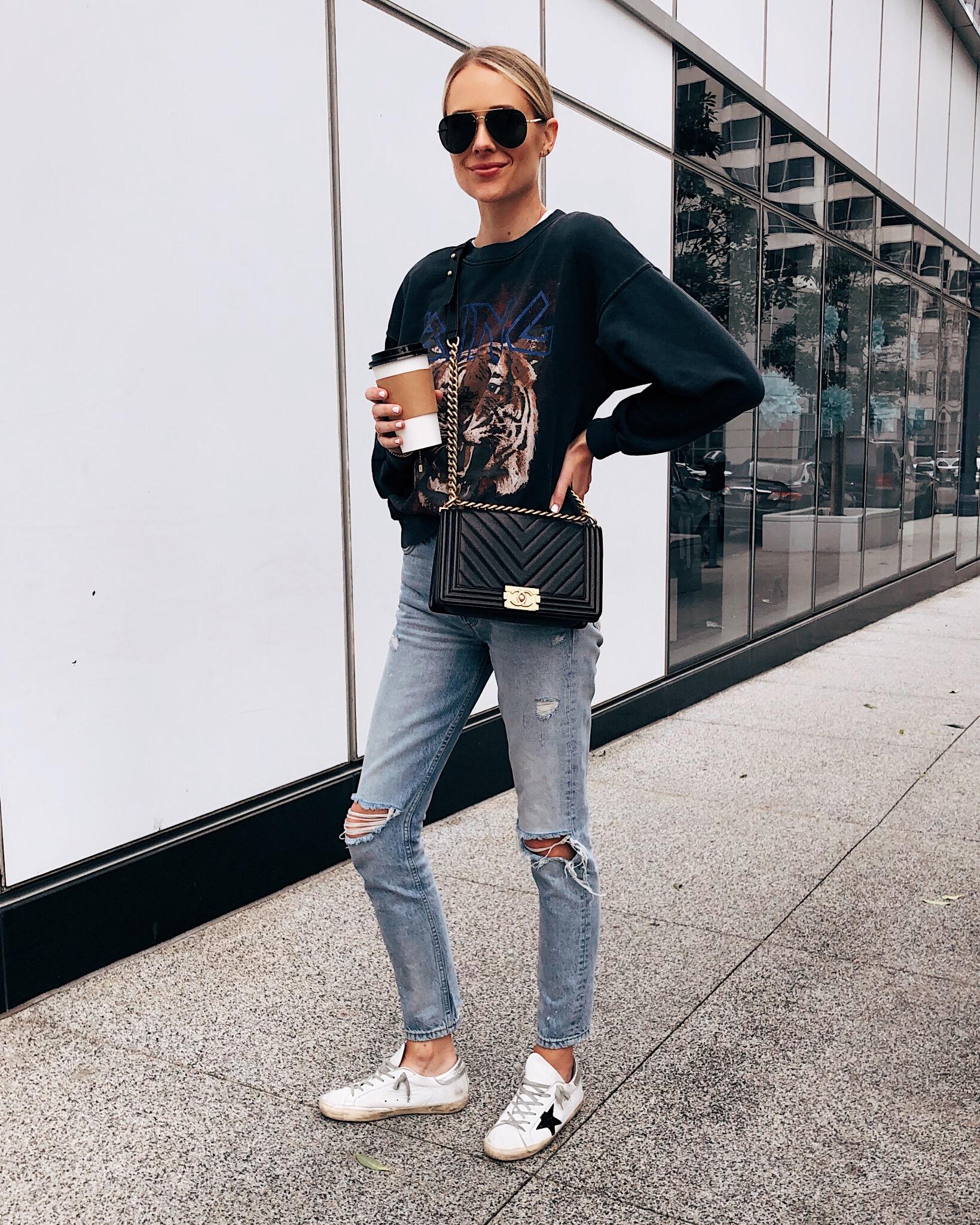 Fashion Jackson Wearing Anine Bing Tiger Sweatshirt Ripped Jeans Golden Goose Sneakers