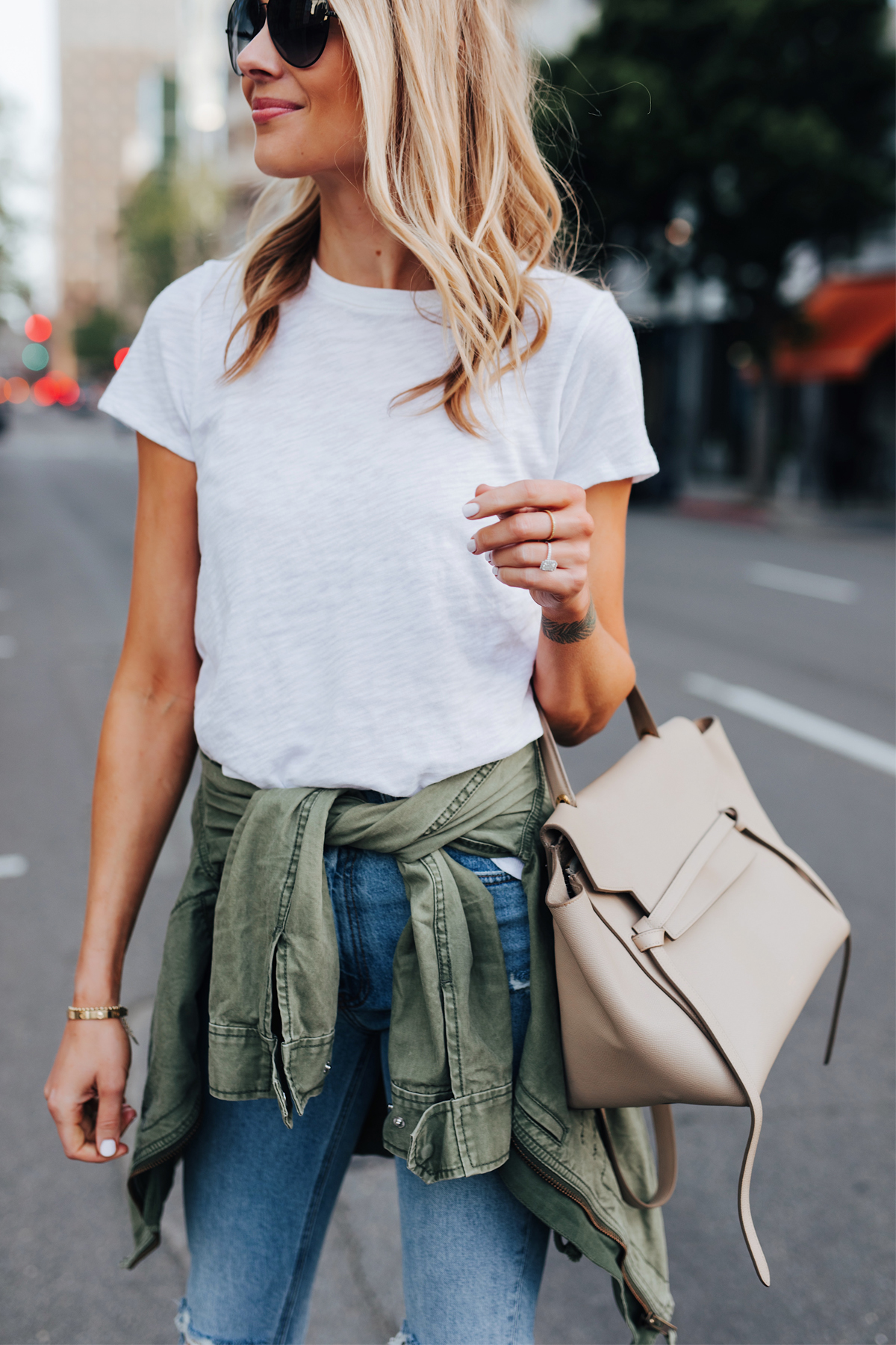 Blonde Woman Wearing ATM White Tshirt Green Utility Jacket Skinny Jeans Black Aviator Sunglasses Celine Mini Belt Bag Fashion Jackson San Diego Fashion Blogger Street Style