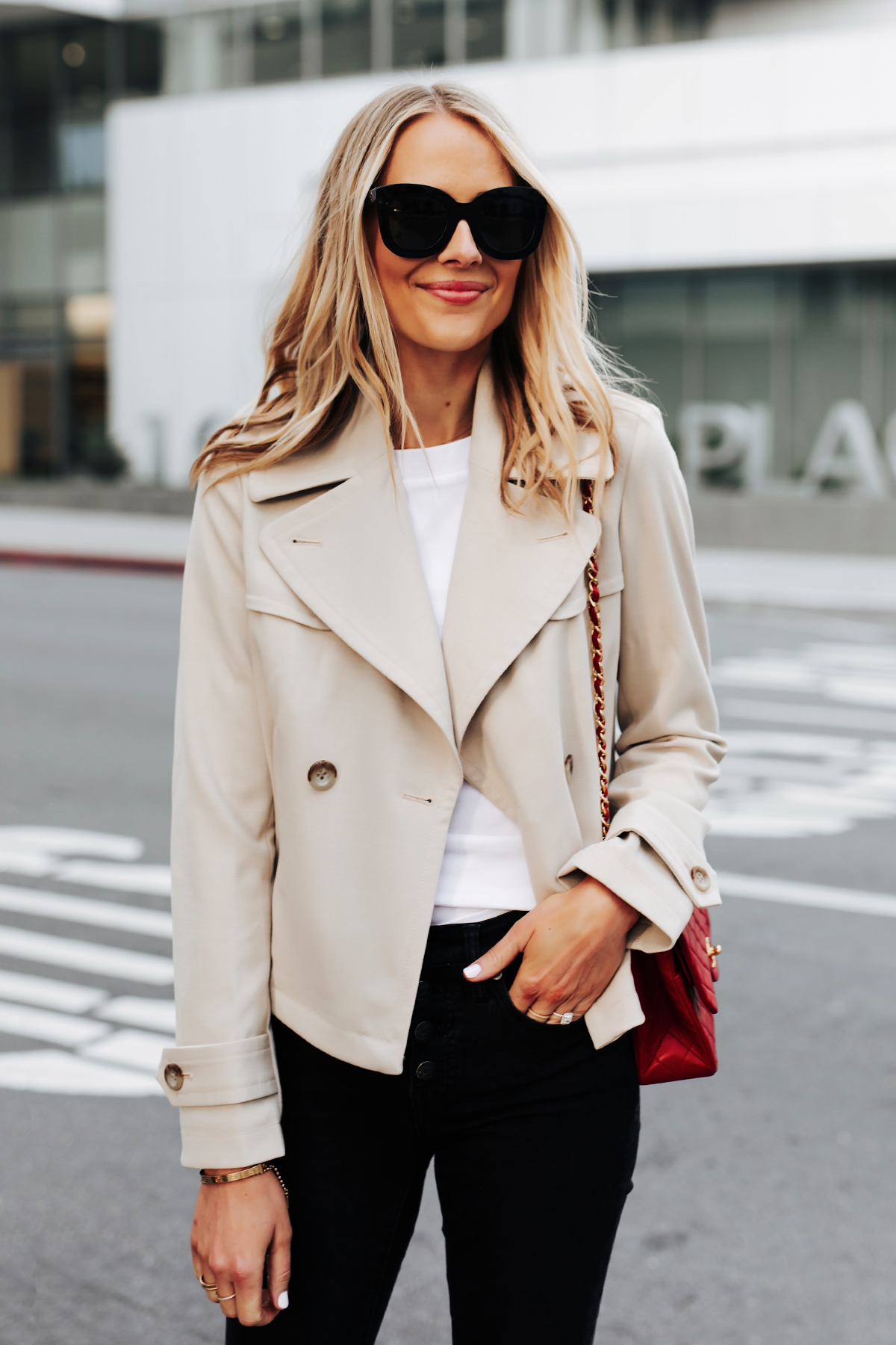 Blonde Woman Wearing Ann Taylor Short Trench Coat White Tshirt Black Jeans Red Handbag Fashion Jackson San Diego Fashion Blogger Street Style