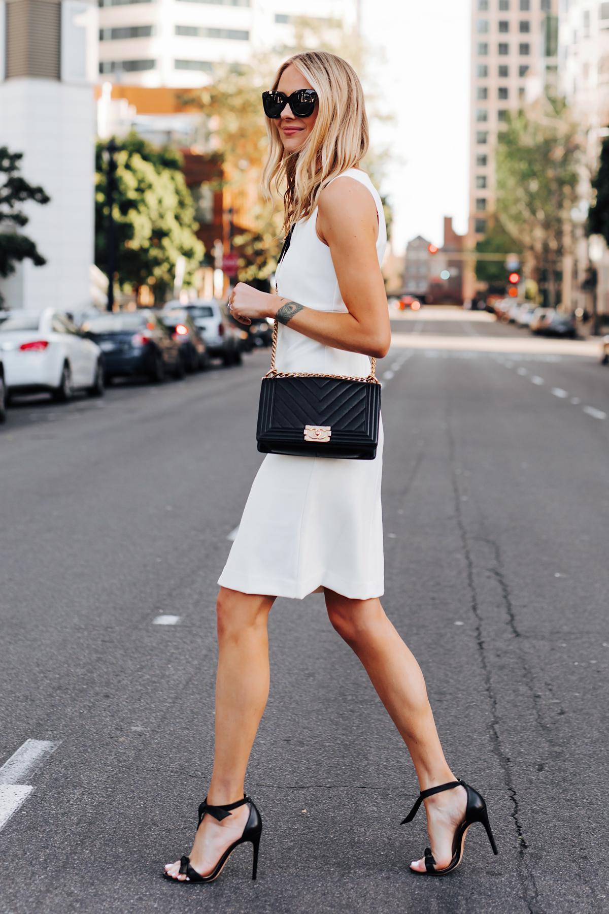 Blonde Woman Wearing Ann Taylor White Dress Chanel Black Boy Bag Alexandre Birman Black Bow Heels Fashion Jackson San Diego Fashion Blogger Street Style