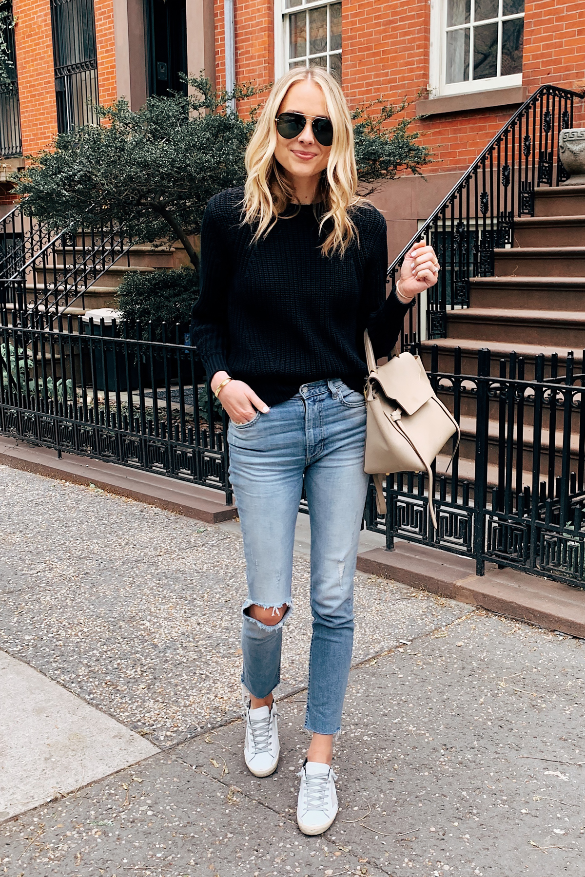 Fashion Jackson Wearing Everlane Black Sweater Boyish Ripped Jeans Golden Goose Sneakers Celine Mini Belt Bag New York City West Village Style