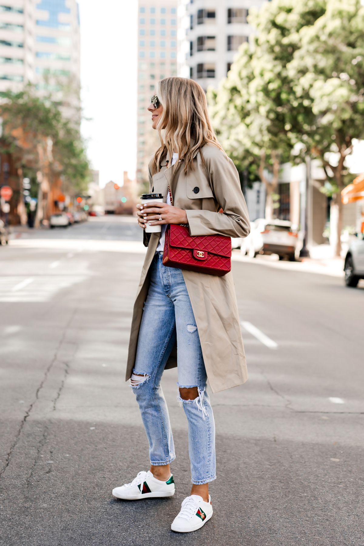 Blonde Woman Wearing Everlane Trench Coat White Tshirt Ripped Jeans Gucci Ace Embroidered Sneakers Red Chanel Handbag Fashion Jackson San Diego Fashion Blogger Street Style