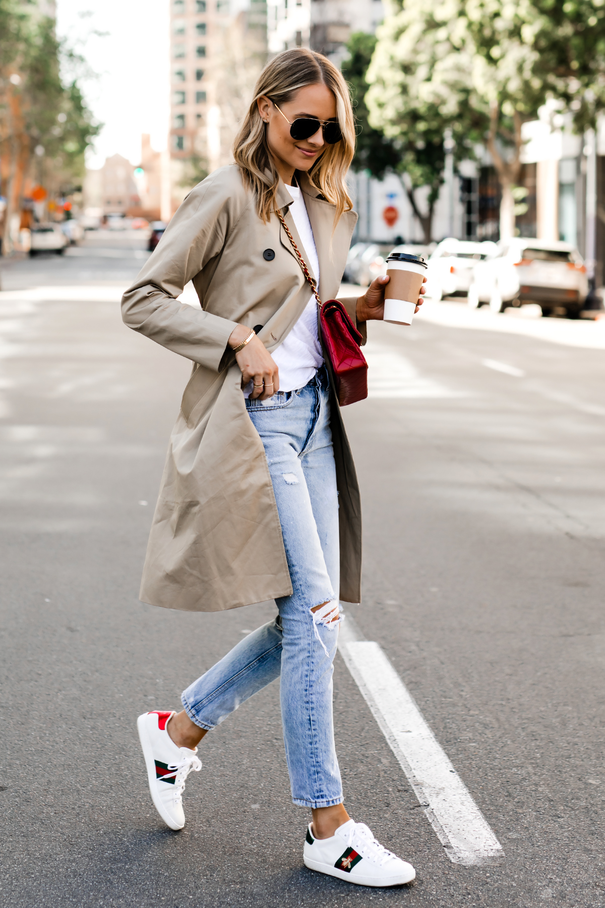 12fc4fb66 Blonde Woman Wearing Everlane Trench Coat White Tshirt Ripped Jeans Gucci  Ace Embroidered Sneakers Fashion Jackson