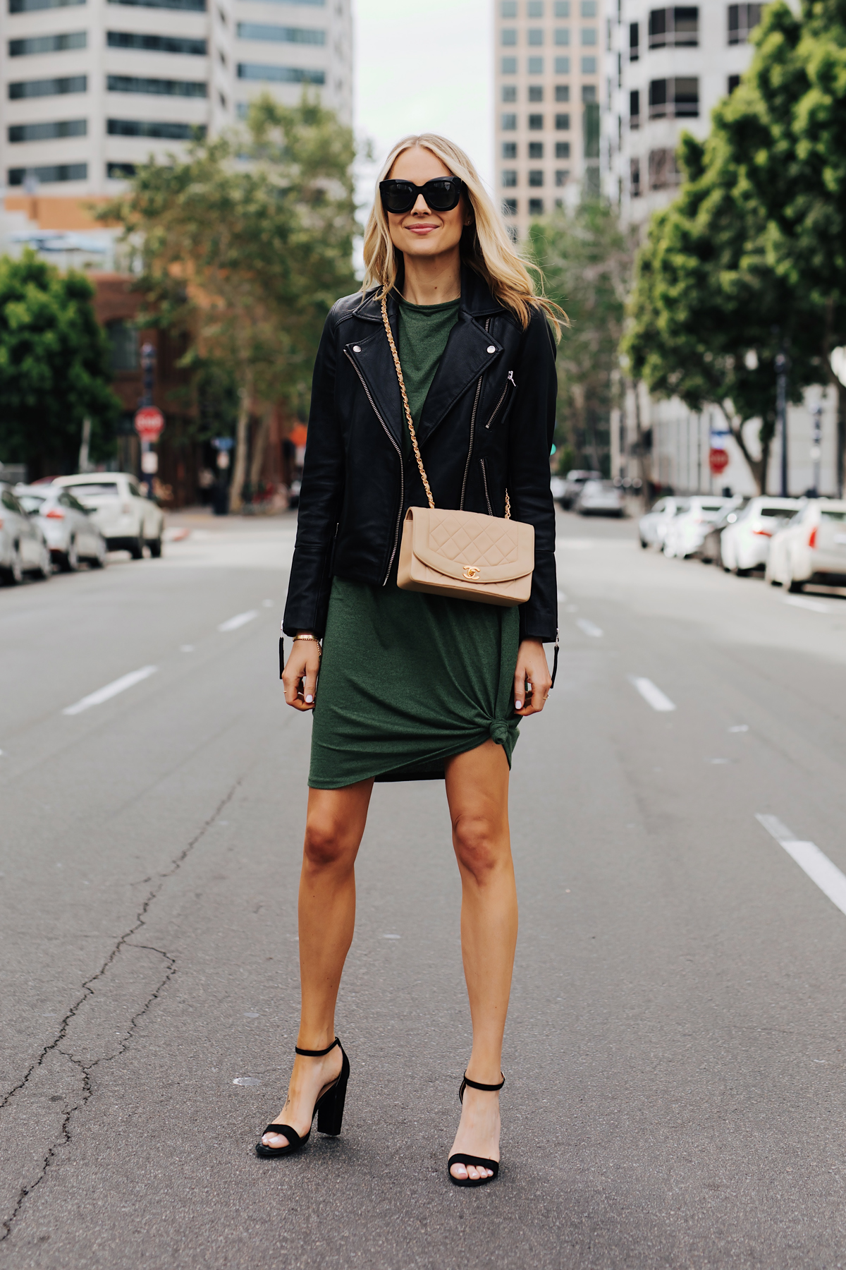 280d21810b6f Blonde Woman Wearing Green Tshirt Dress Black Leather Jacket Black Heeled  Sandals Chanel Beige Crossbody Fashion