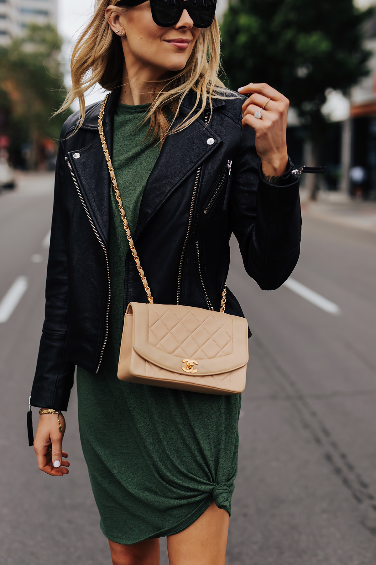 Blonde Woman Wearing Green Tshirt Dress Black Leather Jacket Chanel Beige Crossbody Fashion Jackson San Diego Fashion Blogger Street Style
