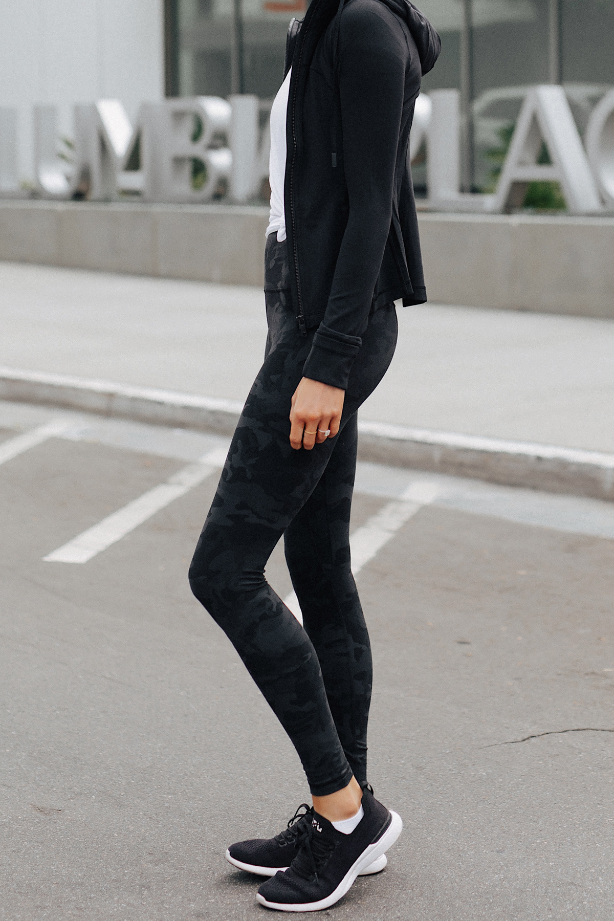Woman Wearing Lululemon Align Pants Black Camo Print Lululemon Black Jacket White Top Fashion Jackson San Diego Fashion Blogger Fitness Style