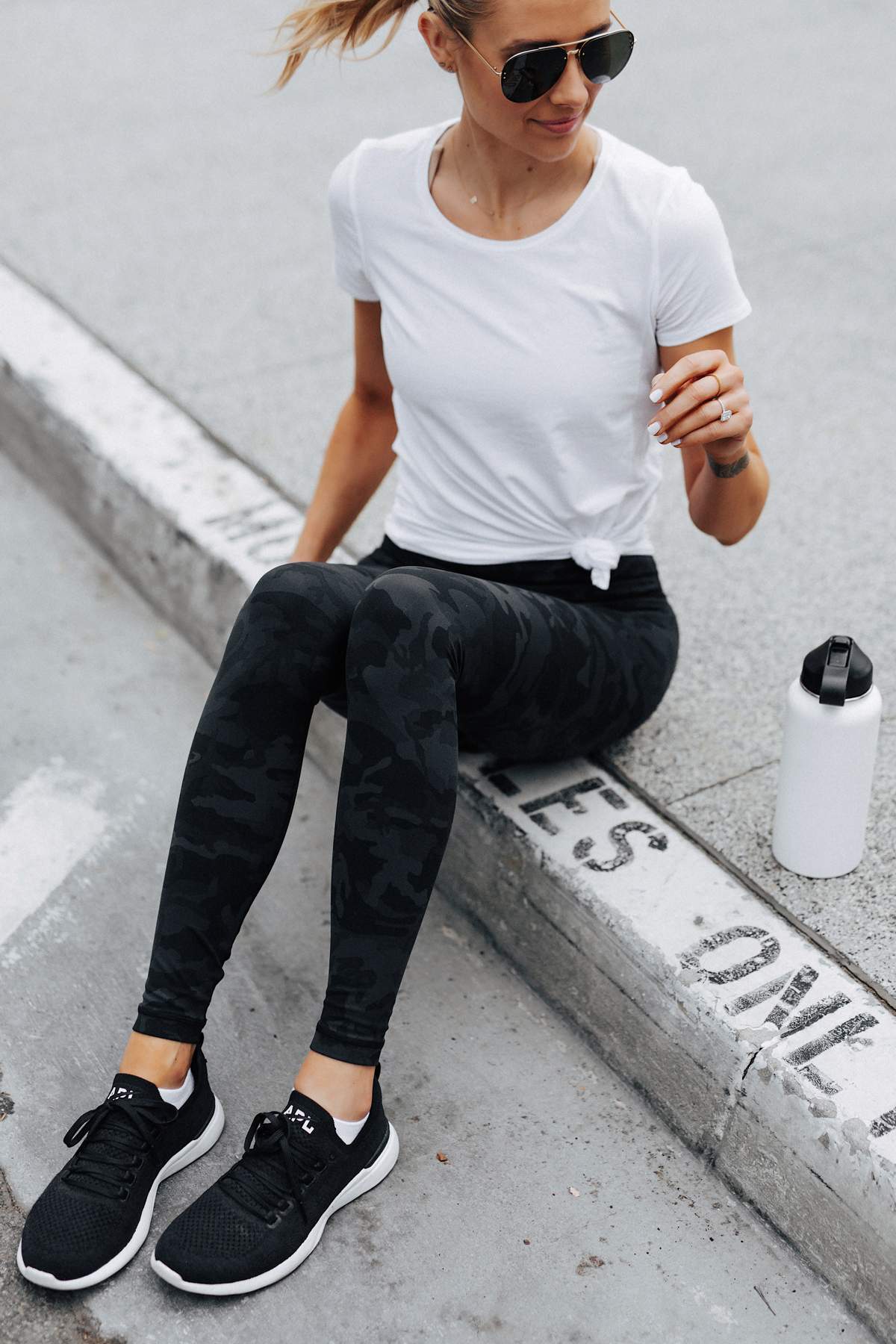 Blonde Woman Wearing Lululemon Align Pants Black Camo Print White Top APL Black Sneakers Fashion Jackson San Diego Fashion Blogger Fitness Style