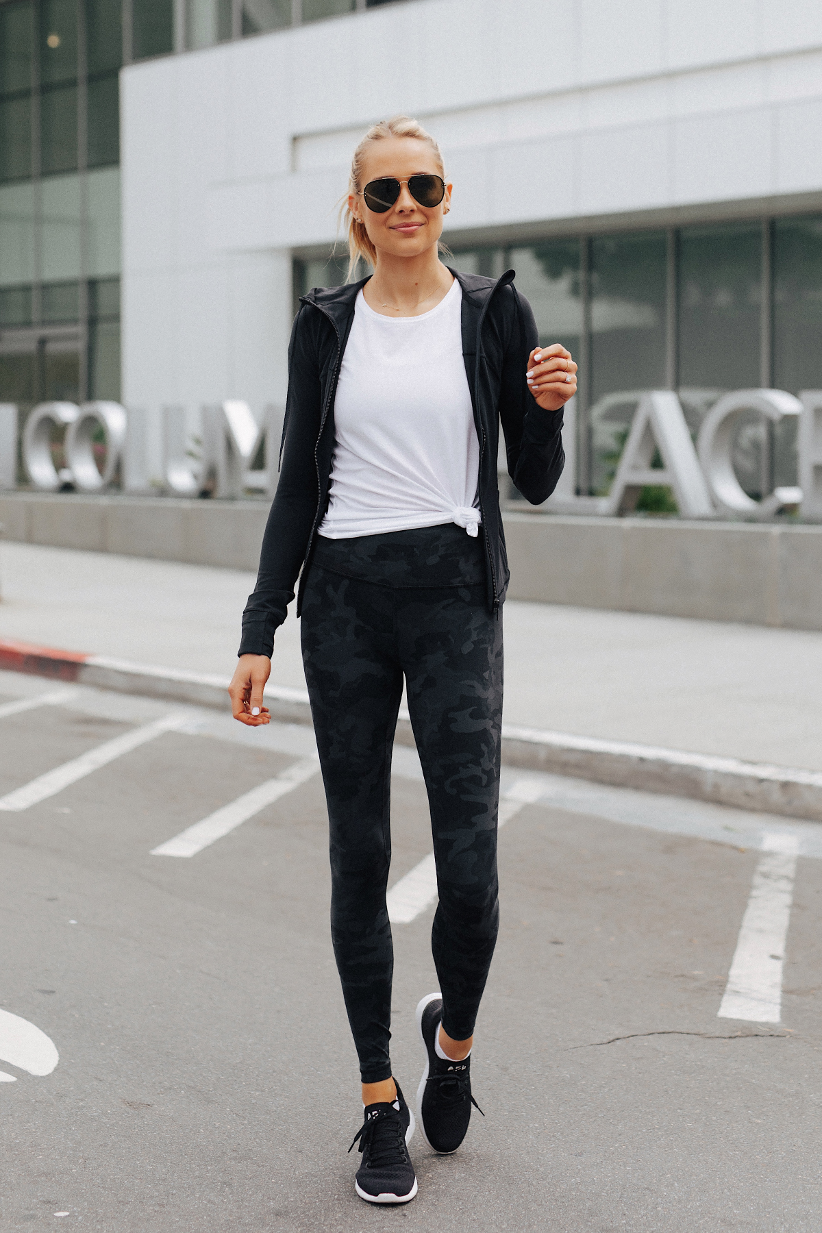 Blonde Woman Wearing Lululemon Align Pants Black Camo Print White Top Black Jacket APL Black Sneakers Fashion Jackson San Diego Fashion Blogger Fitness Style