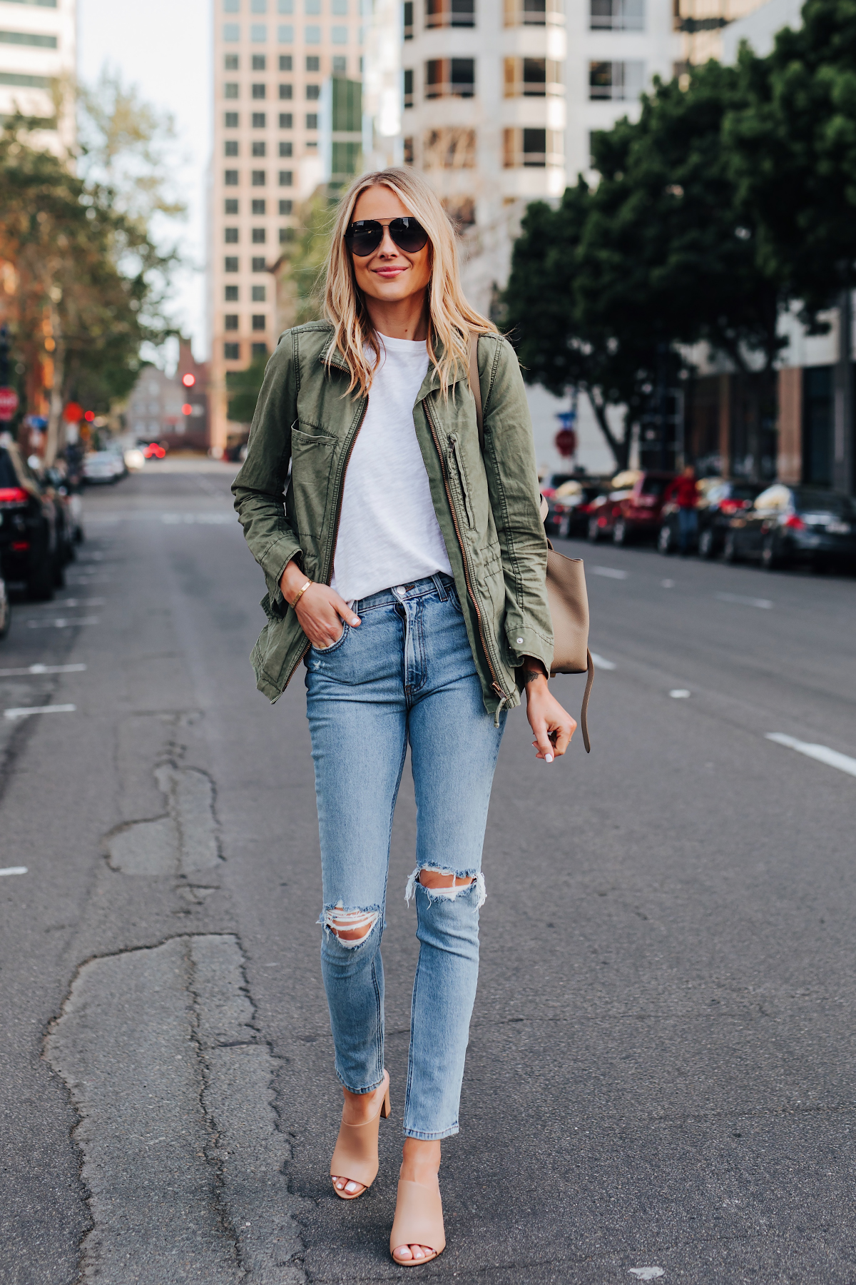 Blonde Woman Wearing Madewell Green Utility Jacket ATM White Tshirt Reformation Ripped Skinny Jeans Vince Hanna Nude Heeled Mules Fashion Jackson San Diego Fashion Blogger Street Style