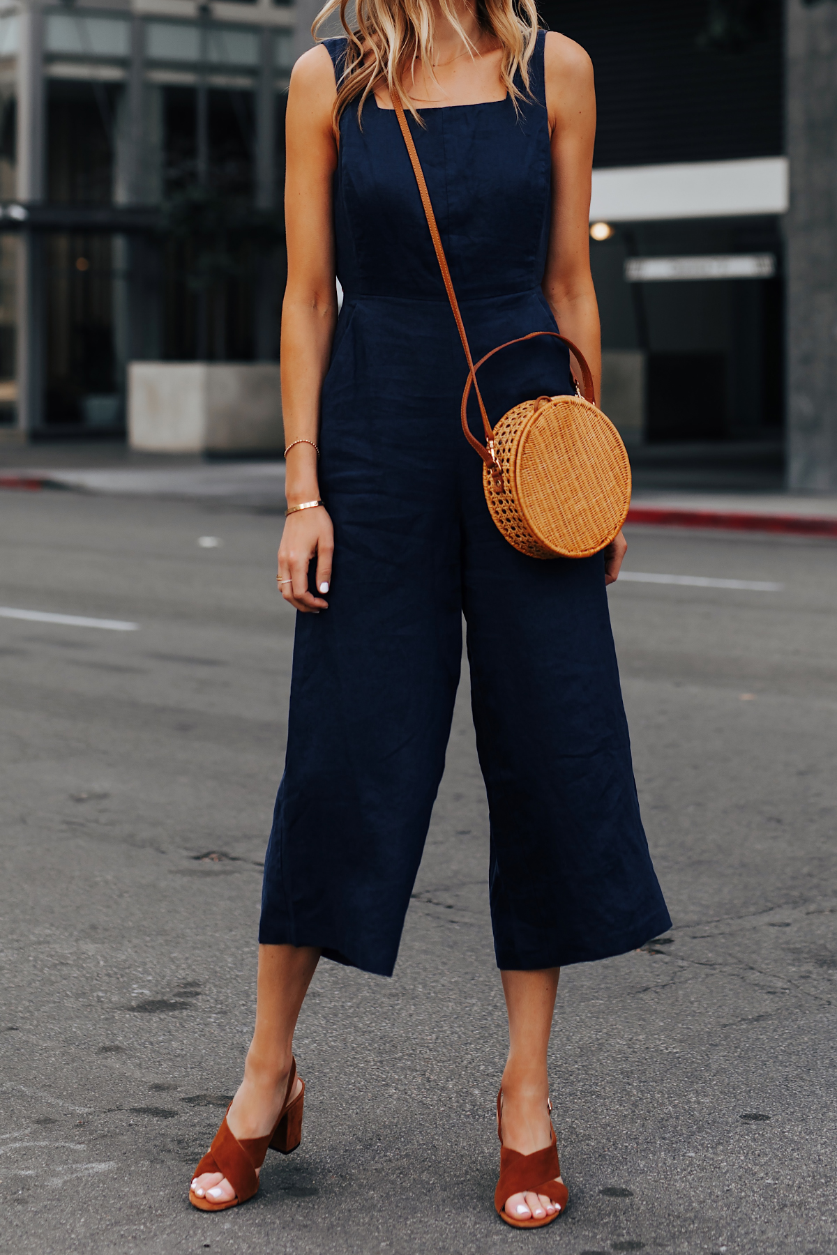 Woman Wearing Navy Jumpsuit Brown Suede Sandals Circle Basket Bag Fashion Jackson San Diego Fashion Blogger Street Style