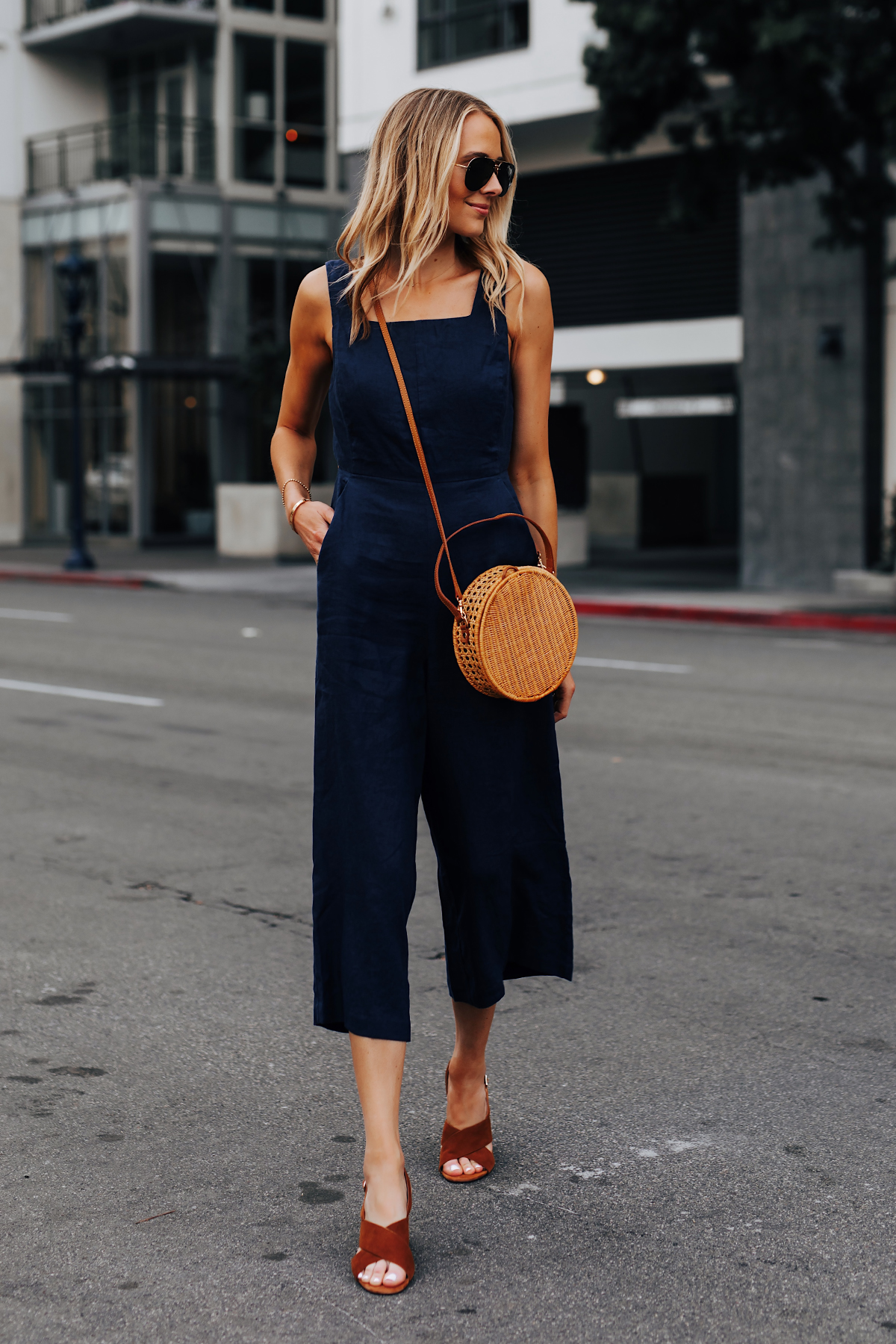 Blonde Woman Wearing Navy Jumpsuit Brown Suede Sandals Circle Basket Bag Fashion Jackson San Diego Fashion Blogger Street Style