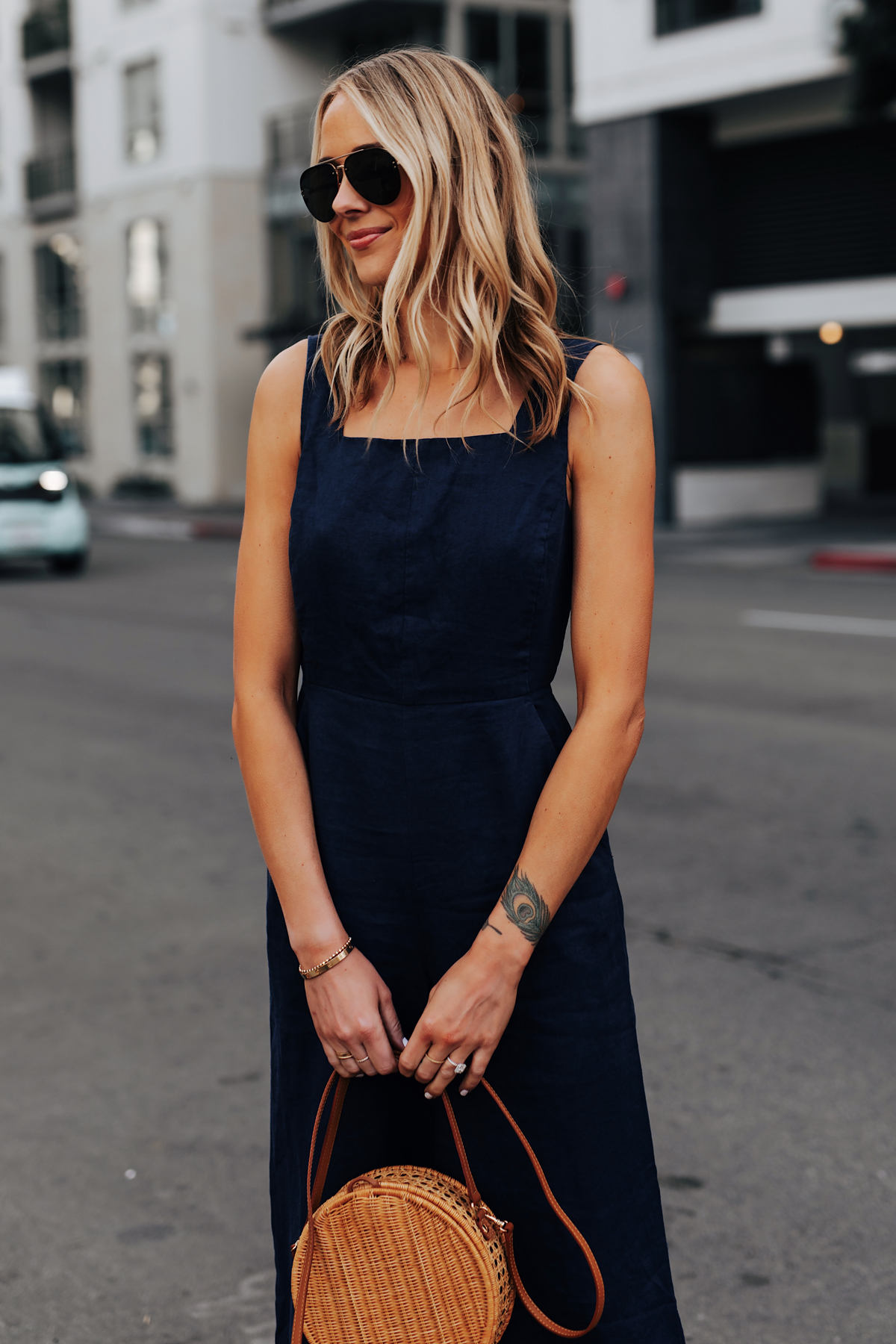 Blonde Woman Wearing Navy Jumpsuit Circle Basket Bag Fashion Jackson San Diego Fashion Blogger Street Style
