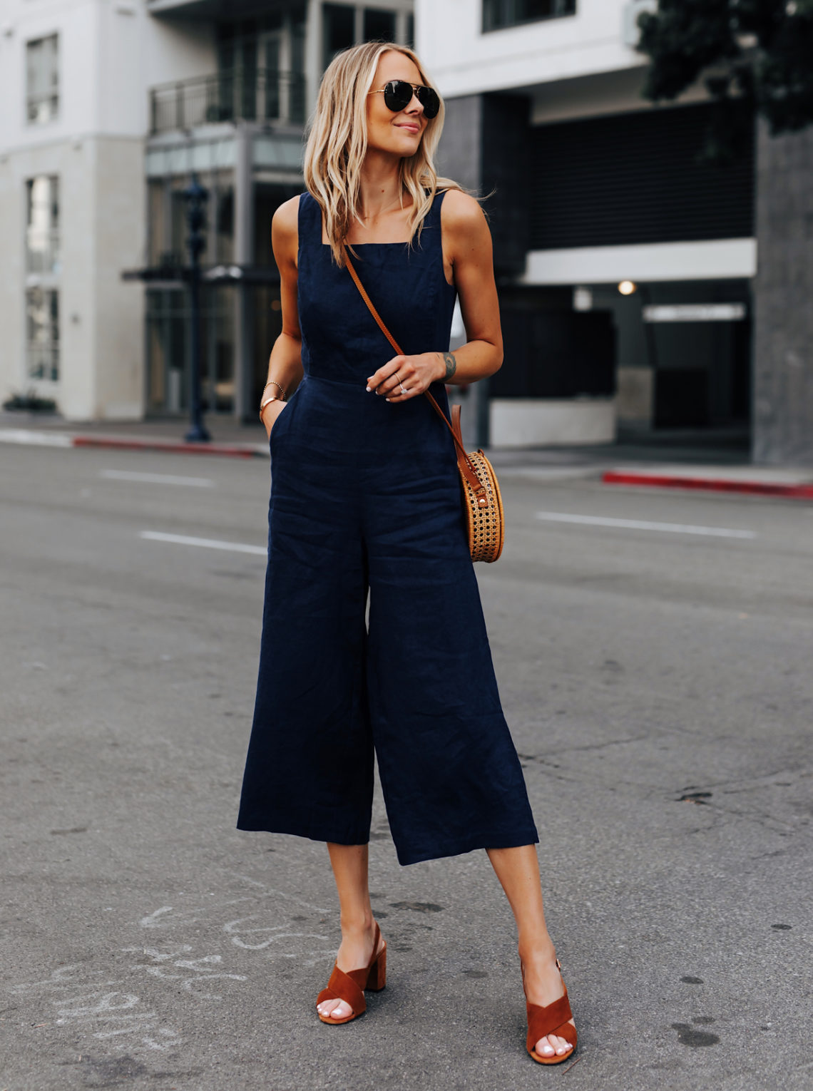 Fashion Jackson Wearing Navy Open Back Jumpsuit Brown Suede Sandals Circle Basket Bag Featured Image