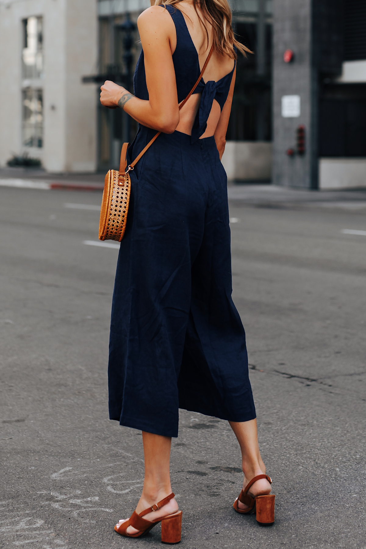 Woman Wearing Navy Open Back Jumpsuit Brown Suede Sandals Circle Basket Bag Fashion Jackson San Diego Fashion Blogger Street Style