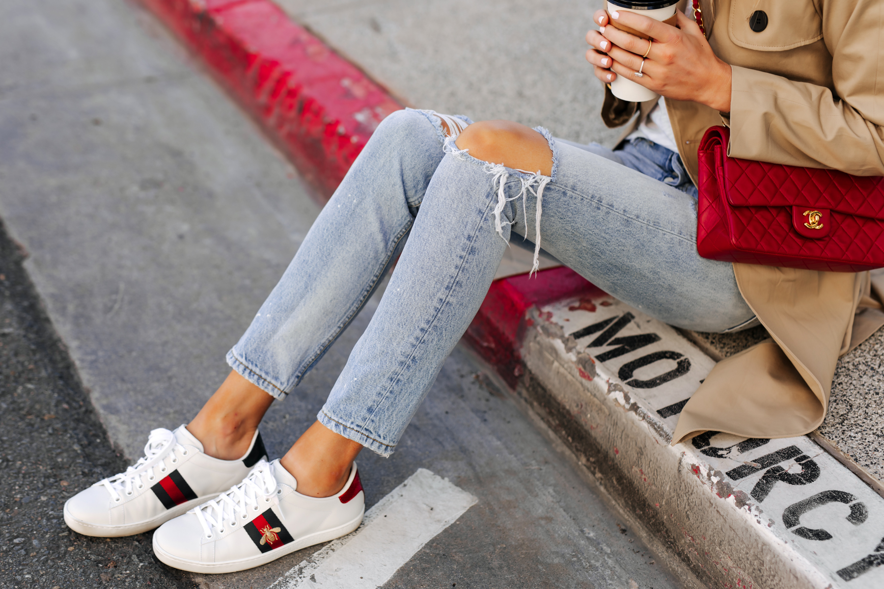 Woman Wearing Trench Coat Ripped Jeans Red Chanel Handbag Gucci Ace Embroidered Sneakers Fashion Jackson San Diego Fashion Blogger Street Style
