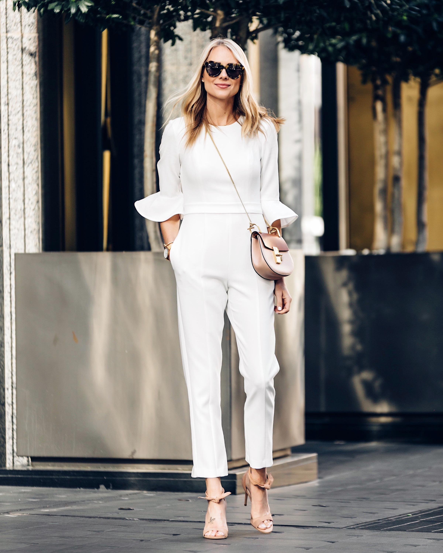 Fashion Jackson Wearing White Jumpsuit