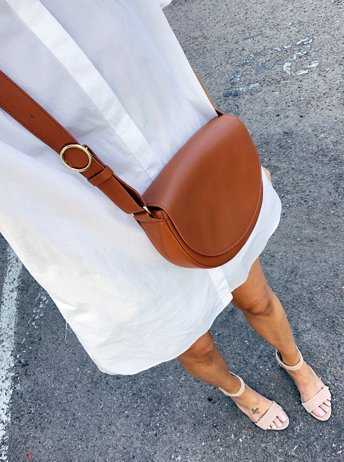 Fashion Jackson Wearing White Shirtdress Tan Handbag