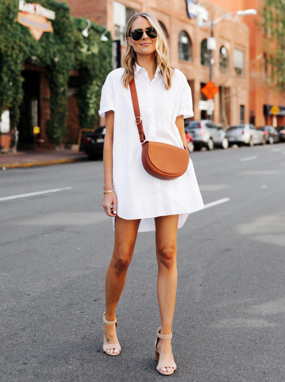Fashion Jackson Wearing White Shirtdress Tan Sandals Cuyana Half Moon Bag Caramel Featured Image