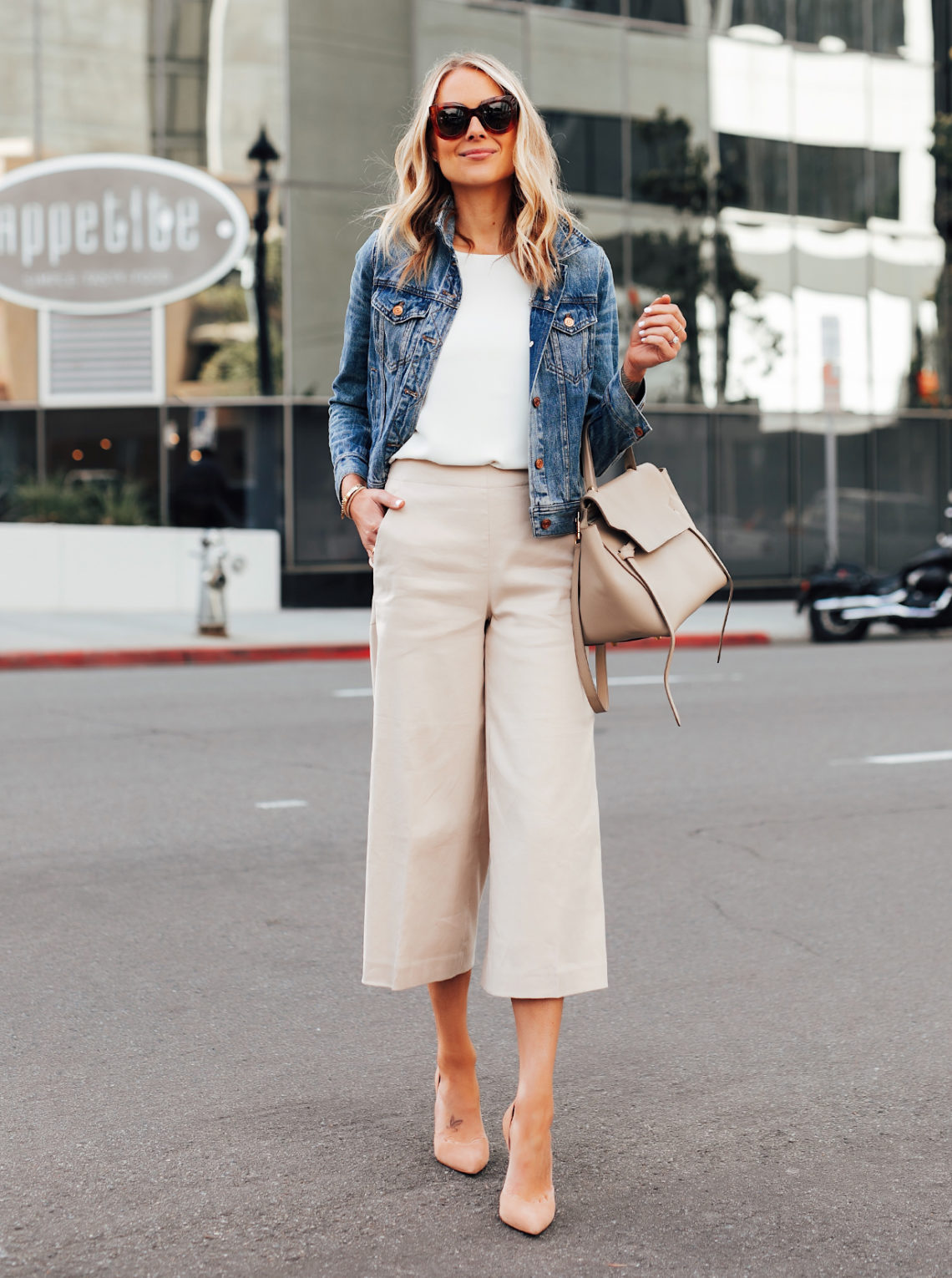 Fashion Jackson Wearing Denim Jacket White Top Ann Taylor Khaki Cropped Pants Nude Heels Celine Mini Belt Bag Featured Image