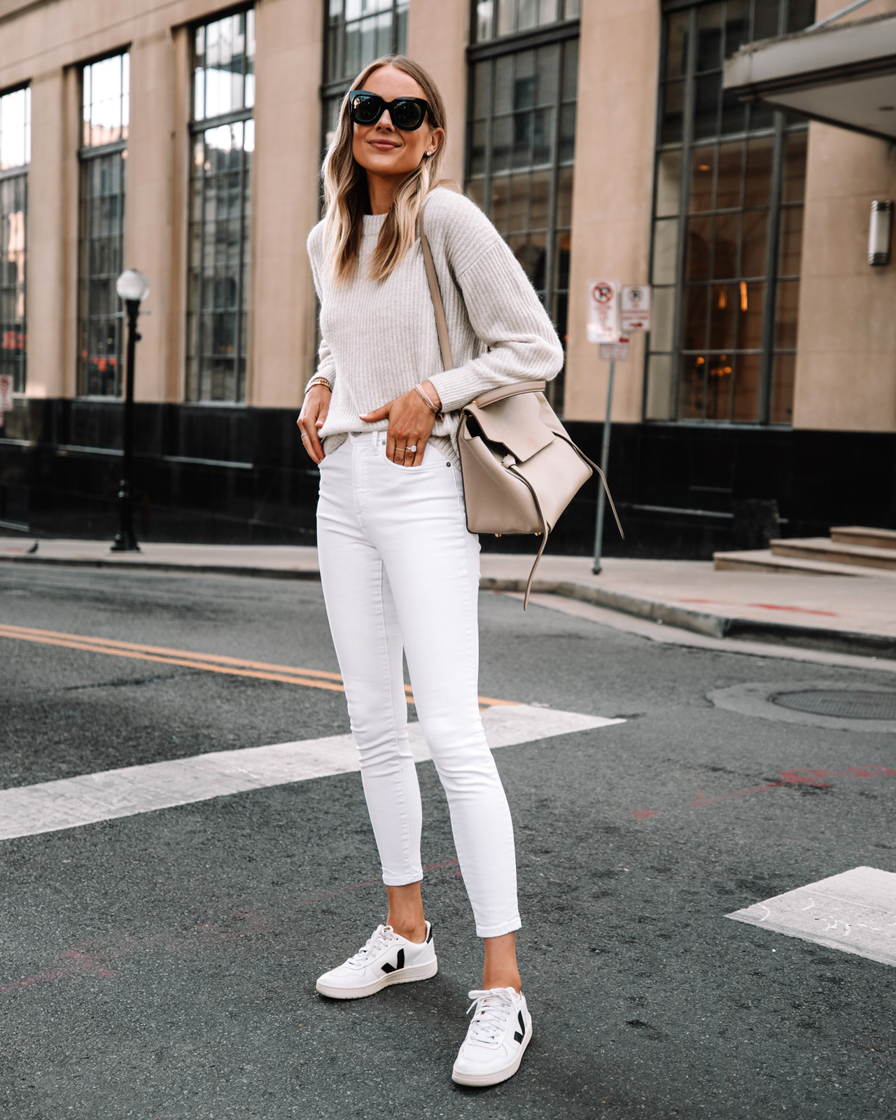 Fashion Jackson Wearing Everlane Beige Sweater White Skinny Jeans Veja Sneakers Outfit