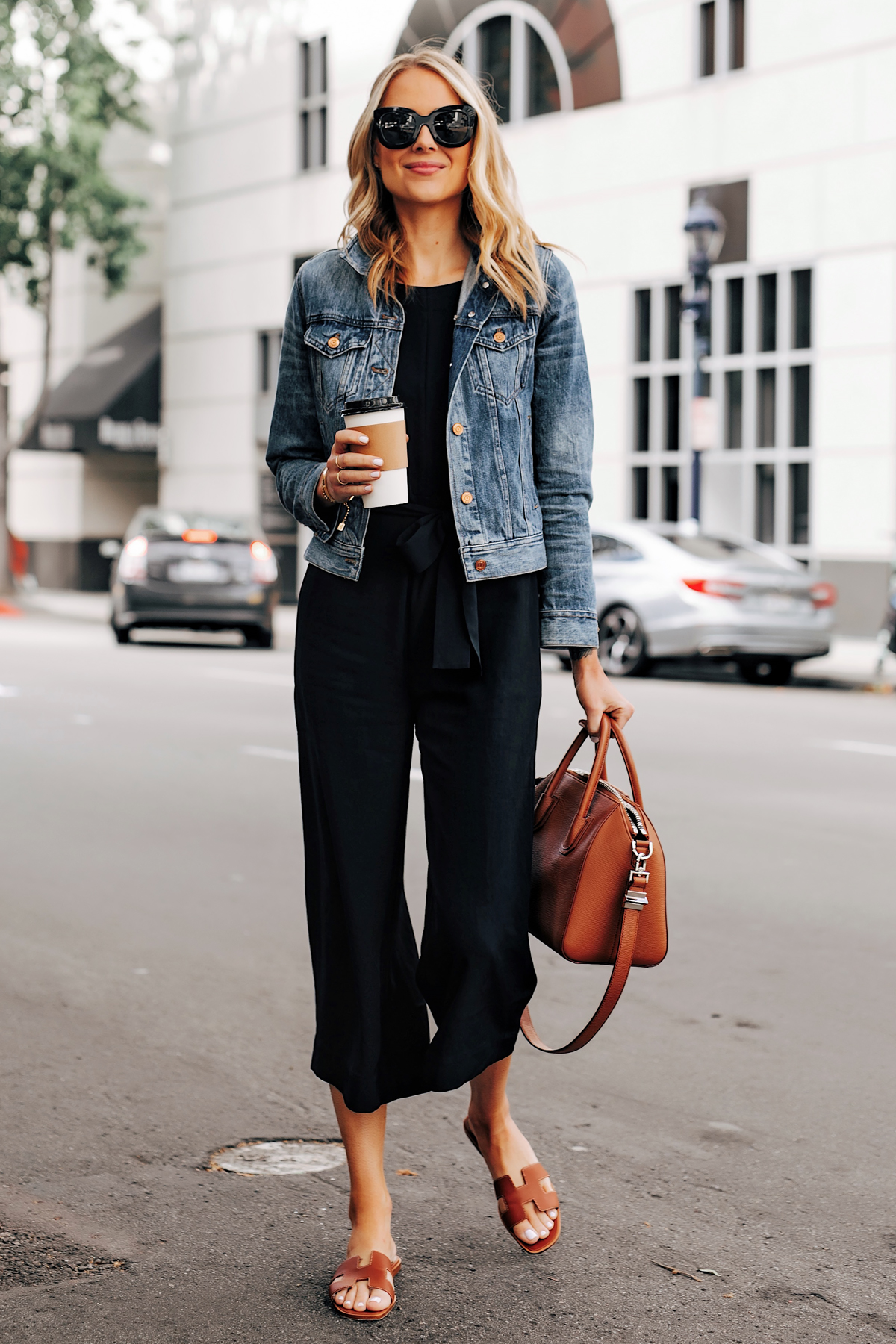 Blonde Woman Wearing Everlane Black Jumpsuit Denim Jacket Brown Sandals Brown Tote Fashion Jackson San Diego Fashion Blogger Street Style
