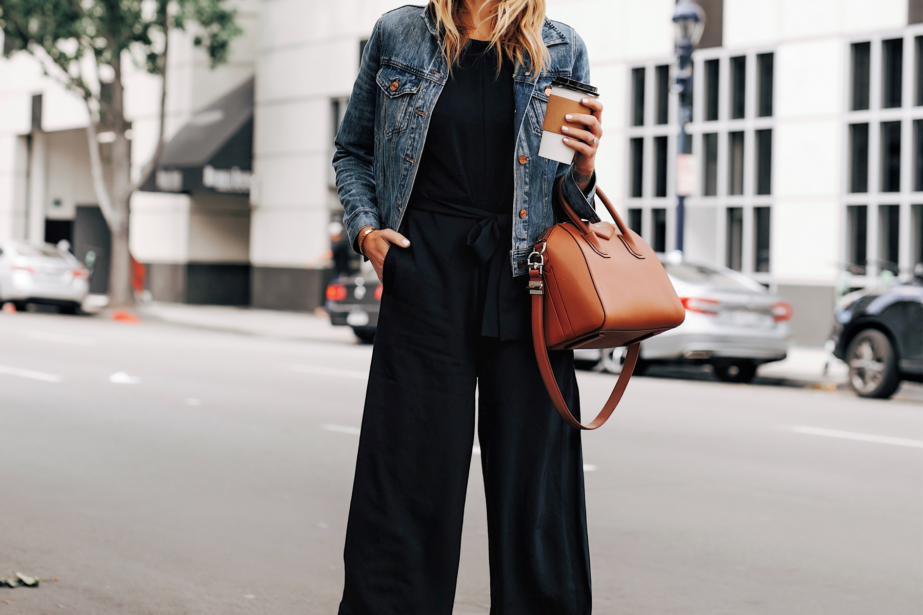 Woman Wearing Everlane Black Tie Waist Jumpsuit Denim Jacket Fashion Jackson San Diego Fashion Blogger Street Style
