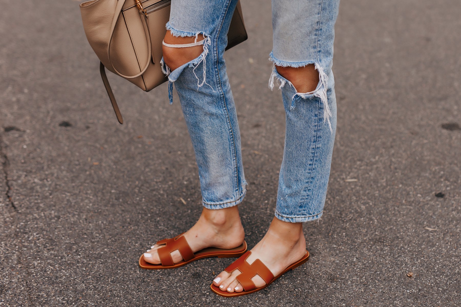 Woman Wearing Ripped Jeans Hermes Oran Gold Sandals Fashion Jackson San Diego Fashion Blogger Street Style