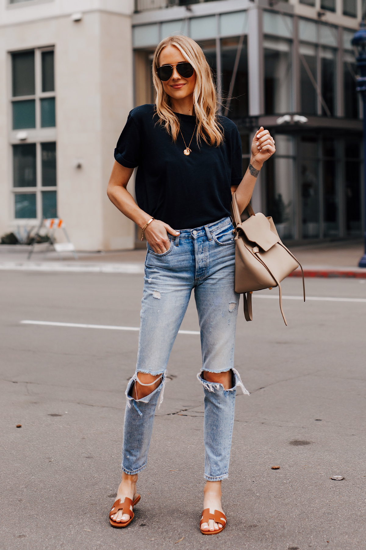 Blonde Woman Wearing Black Tshirt Boyish Ripped Jeans Hermes Oran Gold Sandals Celine Mini Belt Bag Fashion Jackson San Diego Fashion Blogger Street Style