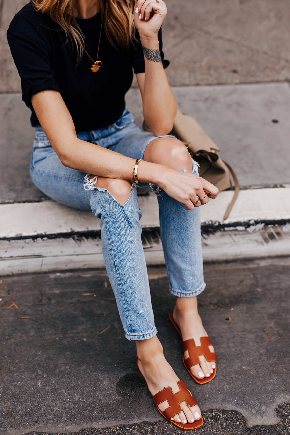 Woman Wearing Black Tshirt Ripped Jeans Hermes Oran Gold Sandals Fashion Jackson San Diego Fashion Blogger Street Style