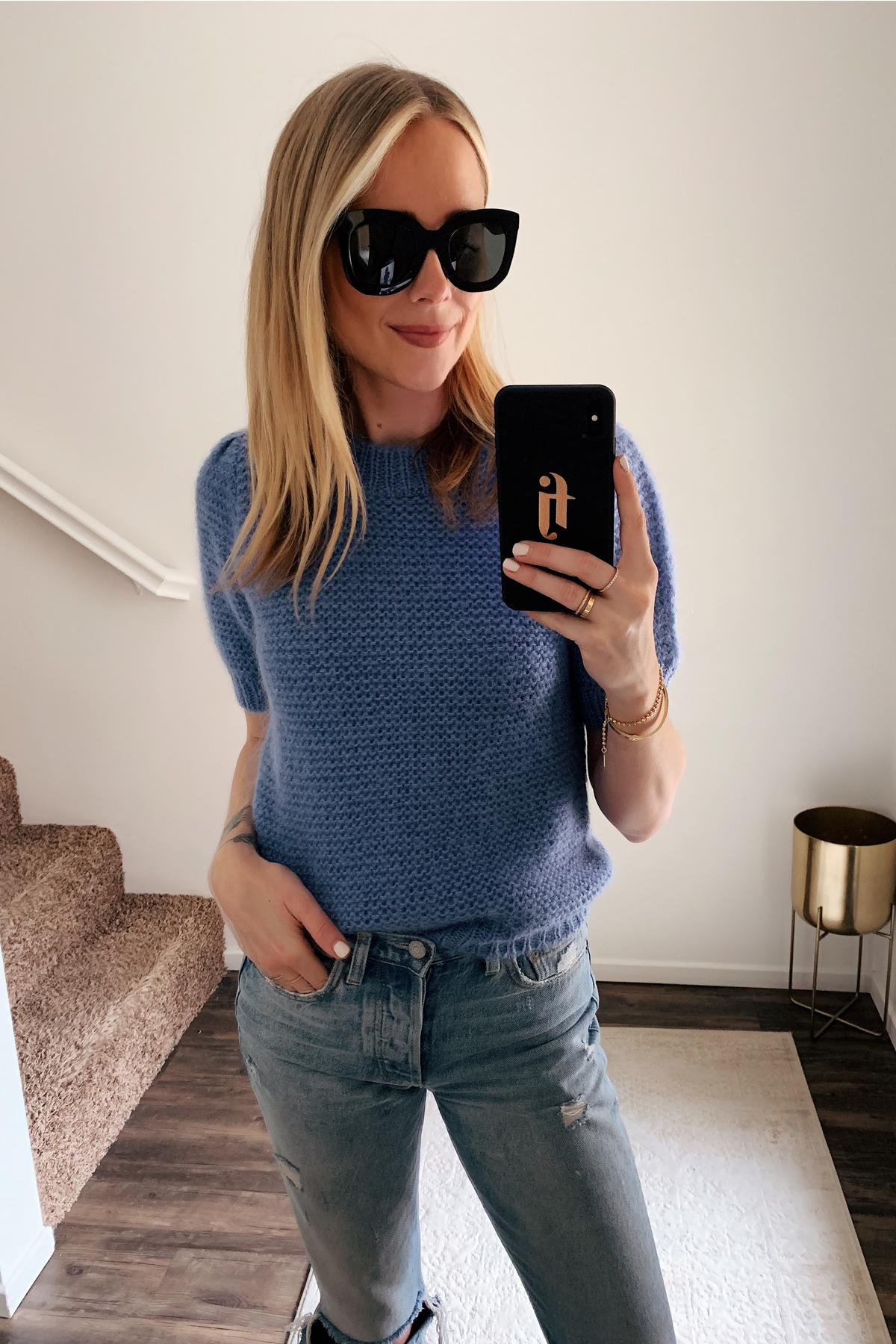 Fashion Jackson Wearing Celine Black Cat Eye Sunglasses Anine Bing Blue Sweater Ripped Jeans