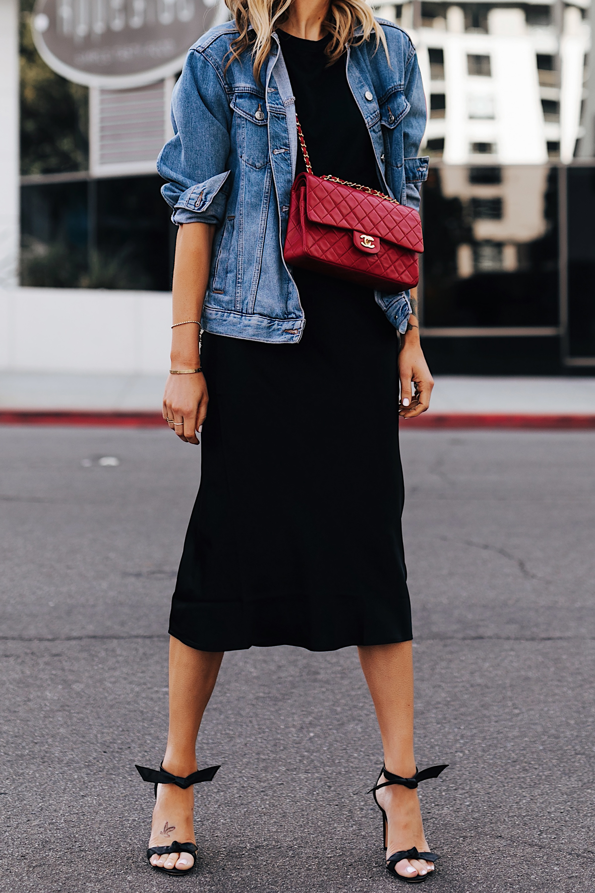 Fashion Jackson Wearing Denim Jacket Black Tshirt Black Silk Skirt Red Chanel Handbag Alexandre Birman Clarita Black Sandals