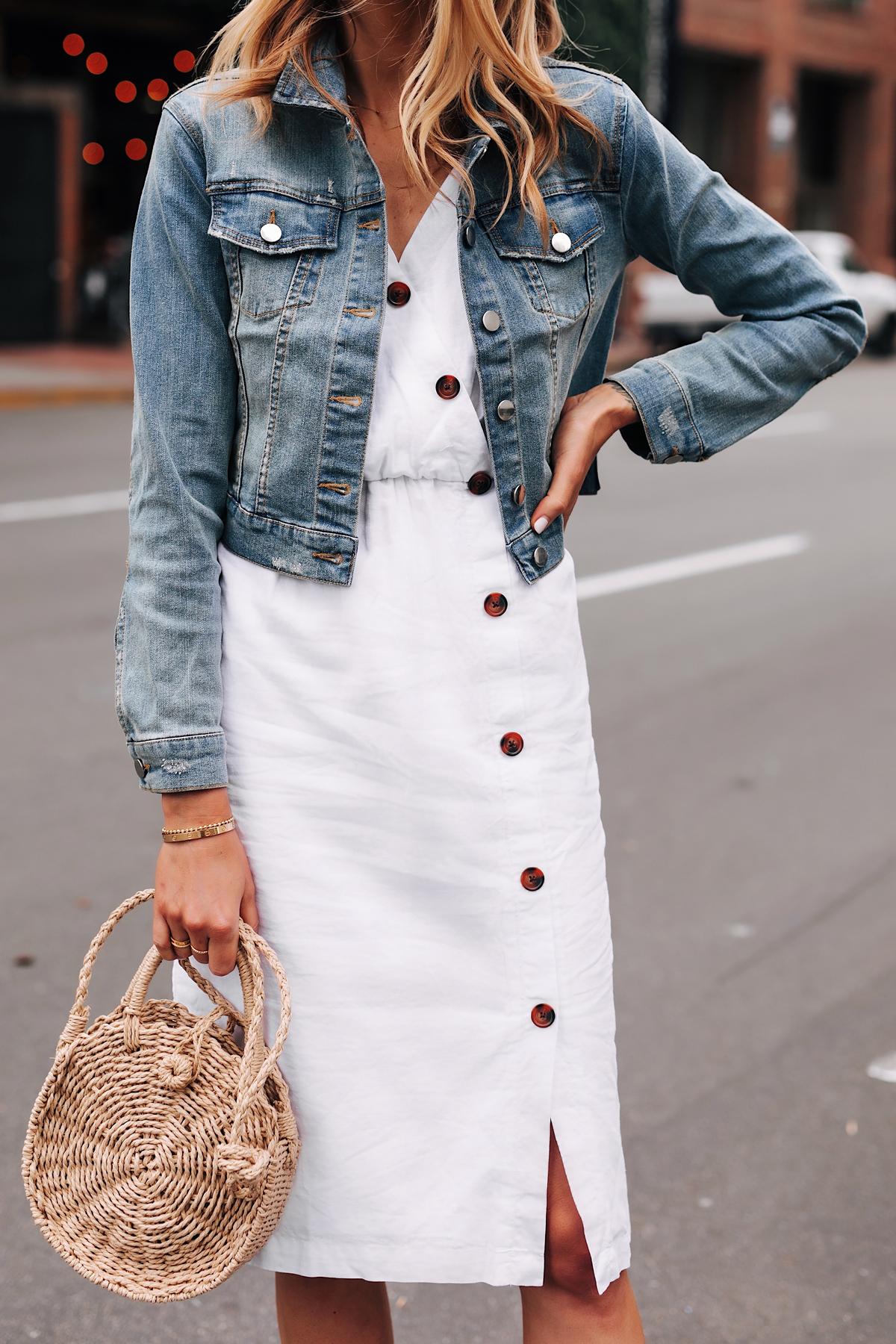 Blonde Woman Wearing Denim Jacket White Button Dress Straw Circle Handbag Fashion Jackson San Diego Fashion Blogger Street Style