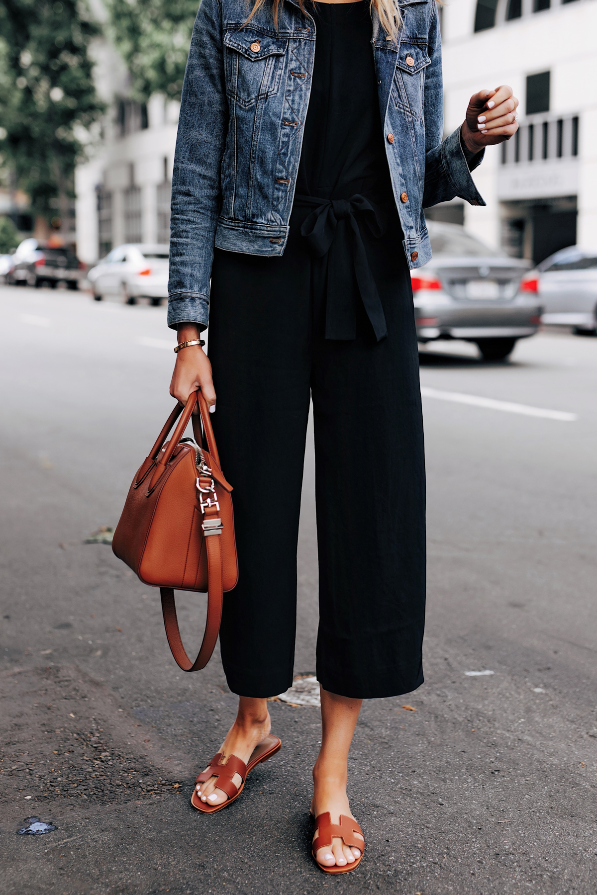 Woman Wearing Everlane Black Jumpsuit Denim Jacket Tan Sandals Tan Tote Fashion Jackson San Diego Fashion Blogger Street Style