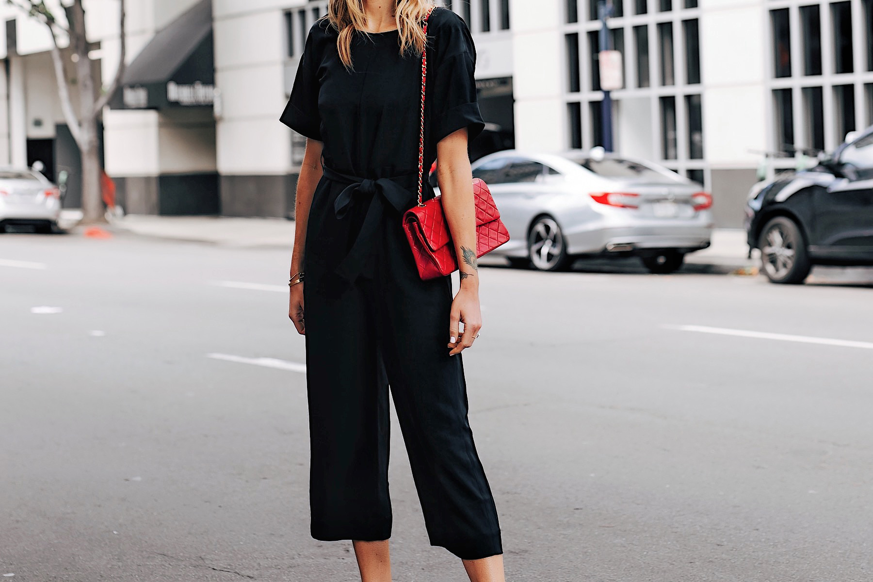 Blonde Woman Wearing Everlane Black Jumpsuit Red Chanel Handbag Fashion Jackson San Diego Fashion Blogger Street Style