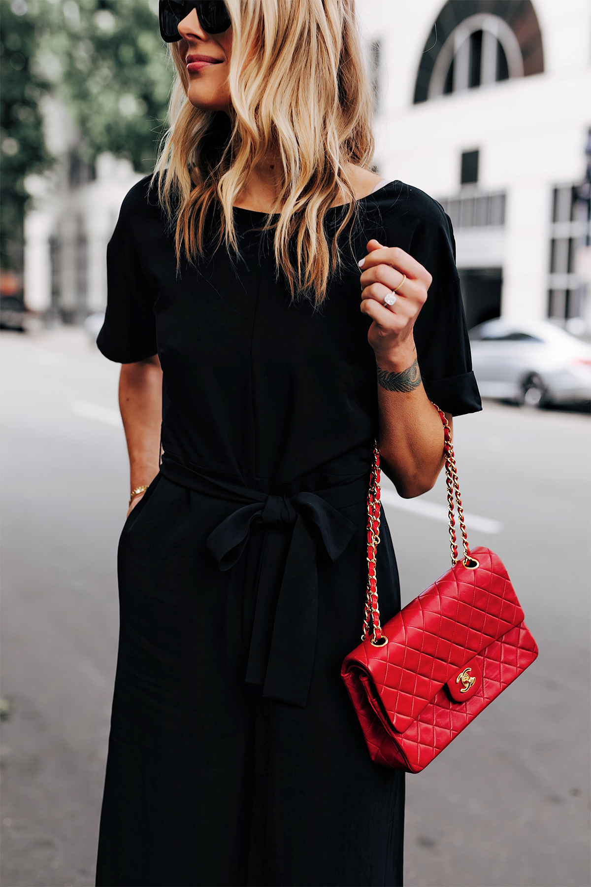 Blonde Woman Wearing Everlane Black Jumpsuit Tie Waist Chanel Classic Red Handbag Fashion Jackson San Diego Fashion Blogger Street Style