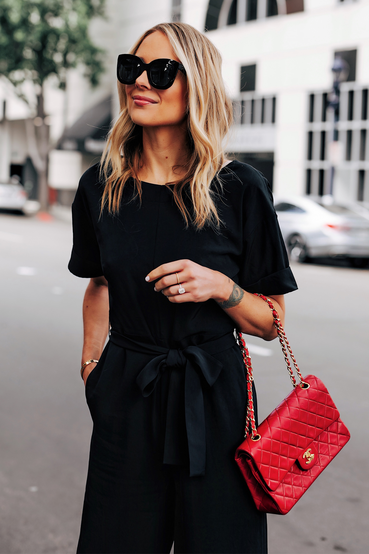 Blonde Woman Wearing Everlane Black Jumpsuit Tie Waist Red Chanel Handbag Fashion Jackson San Diego Fashion Blogger Street Style