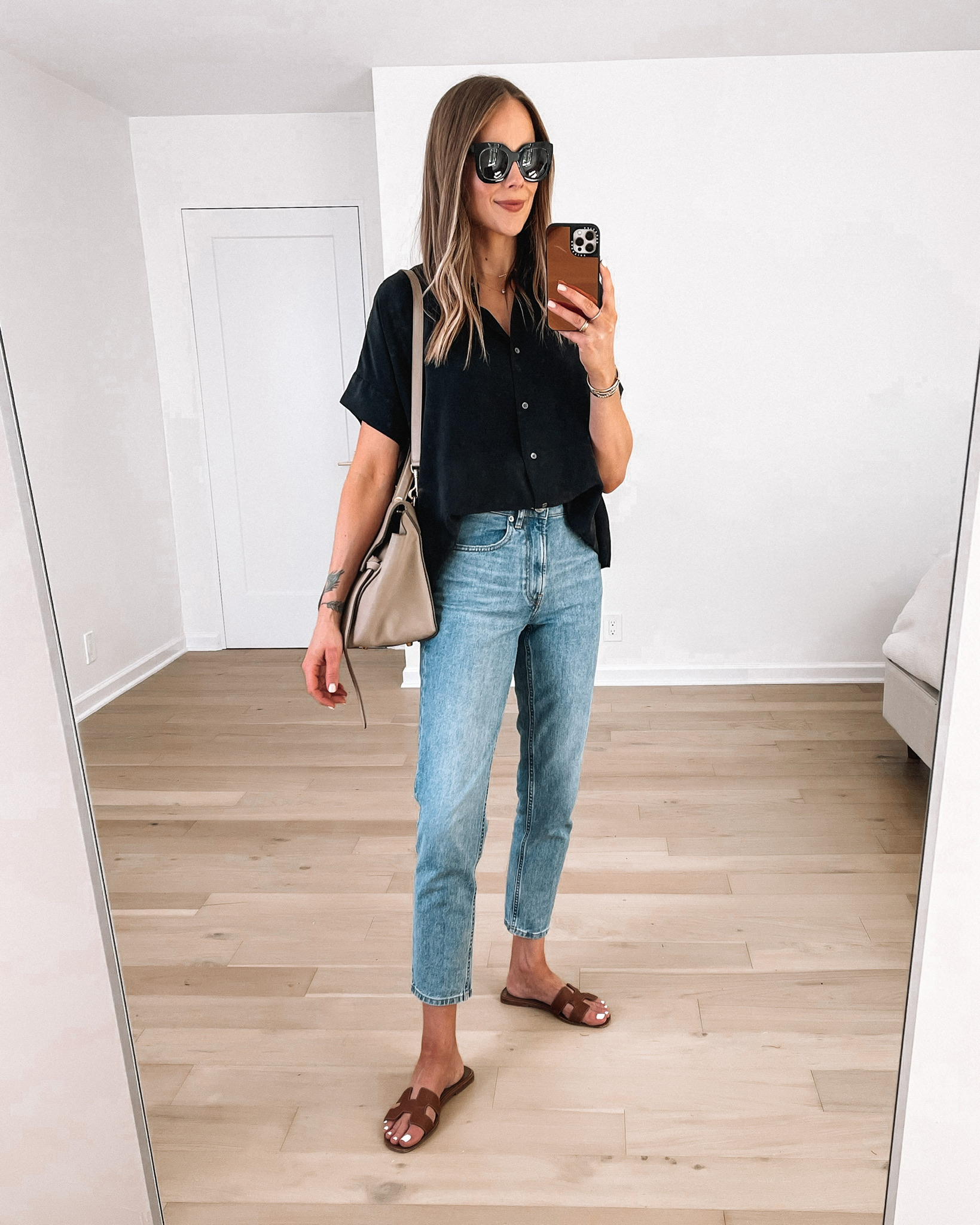 Fashion Jackson Wearing Everlane Black Short Sleeve Shirt Everlane Straight Leg Jeans Hermes Brown Sandals