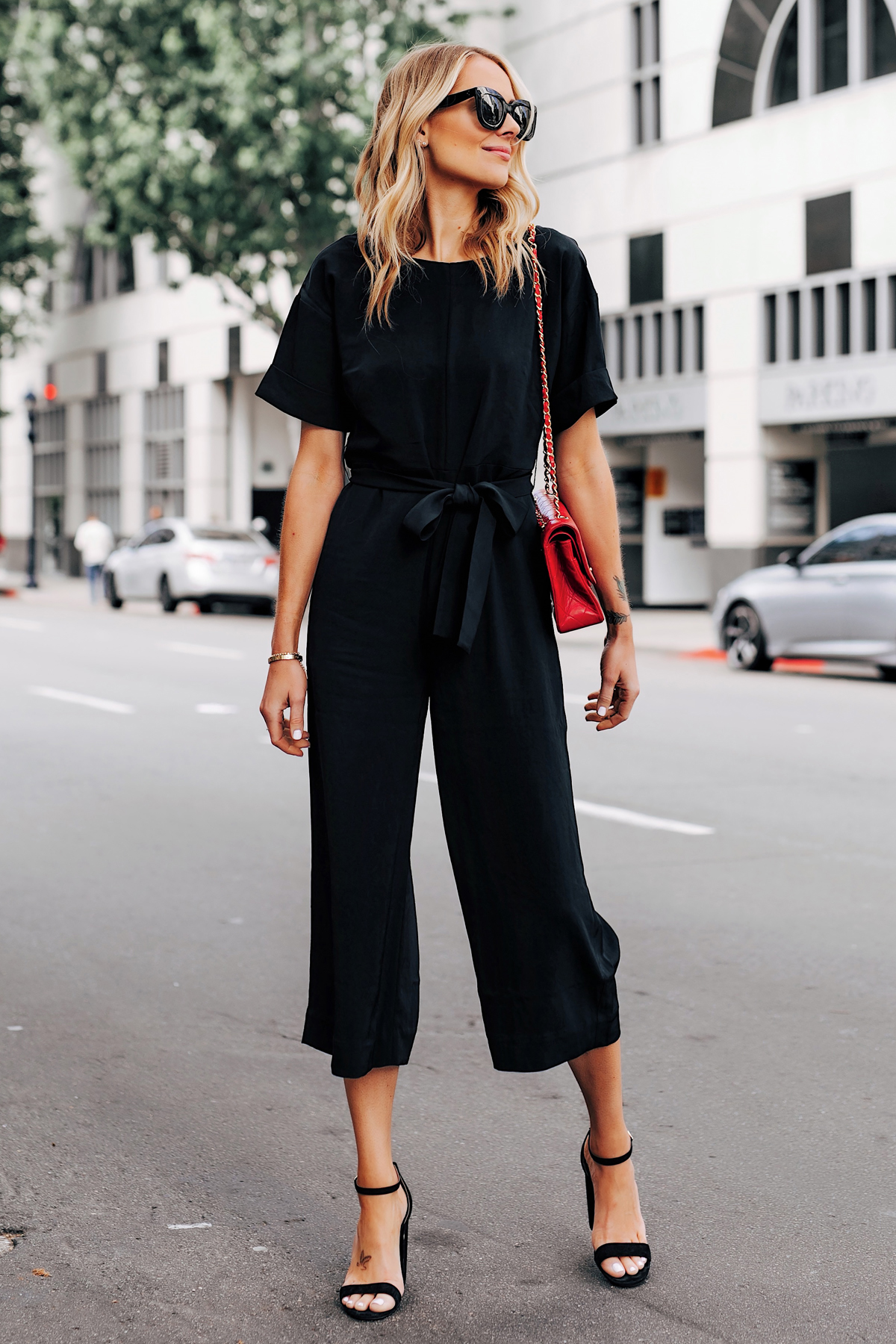 Blonde Woman Wearing Everlane Black Tie Waist Jumpsuit Chanel Red Handbag Black Heeled Sandals Fashion Jackson San Diego Fashion Blogger Street Style
