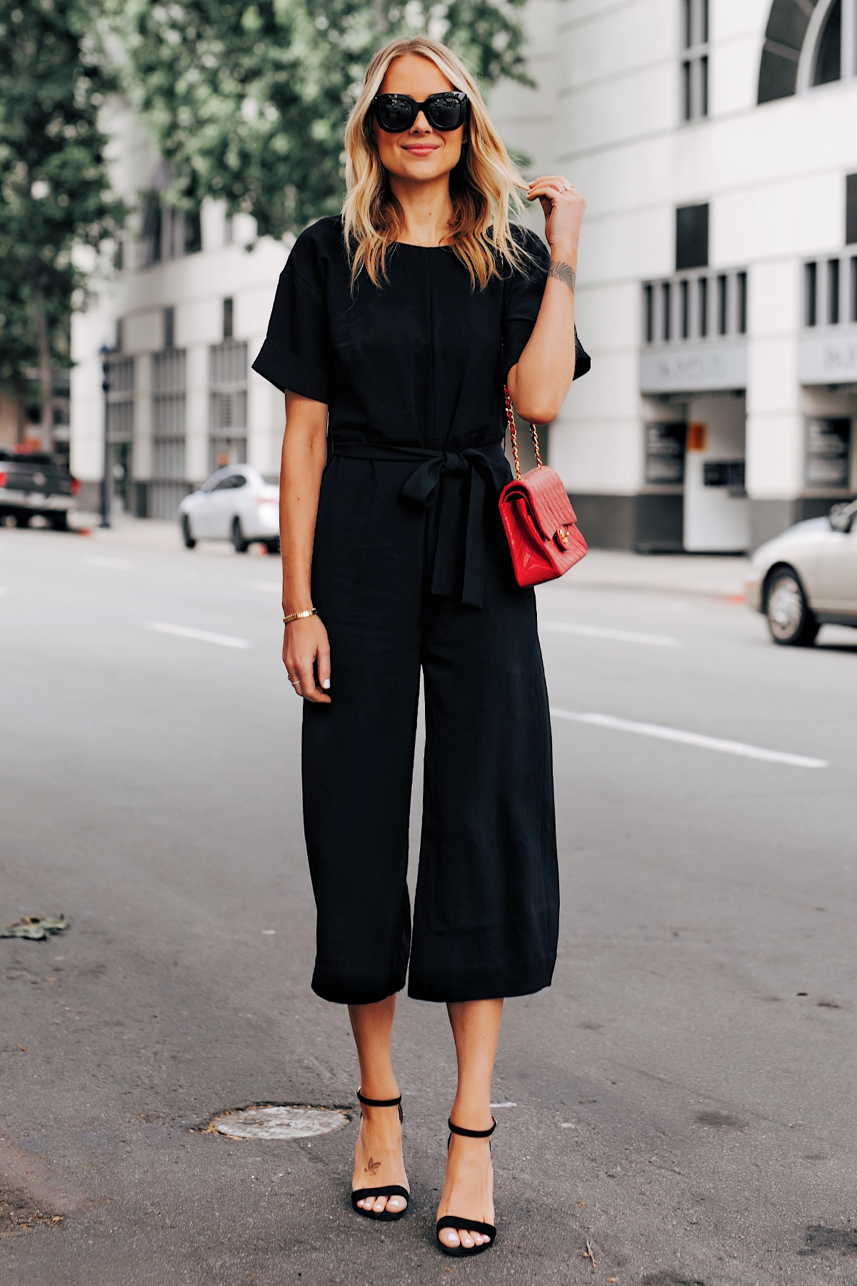 Blonde Woman Wearing Everlane Tie Waist Black Jumpsuit Red Chanel Handbag Black Sandals Fashion Jackson San Diego Fashion Blogger Street Style
