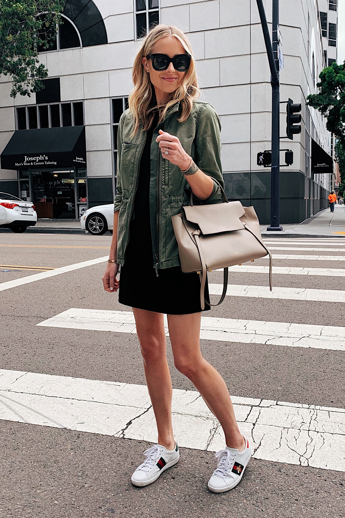 64806cc23057f Fashion Jackson Wearing Green Utility Jacket Little Black Dress Gucci Sneakers  Celine Mini Belt Bag. Blonde Woman ...