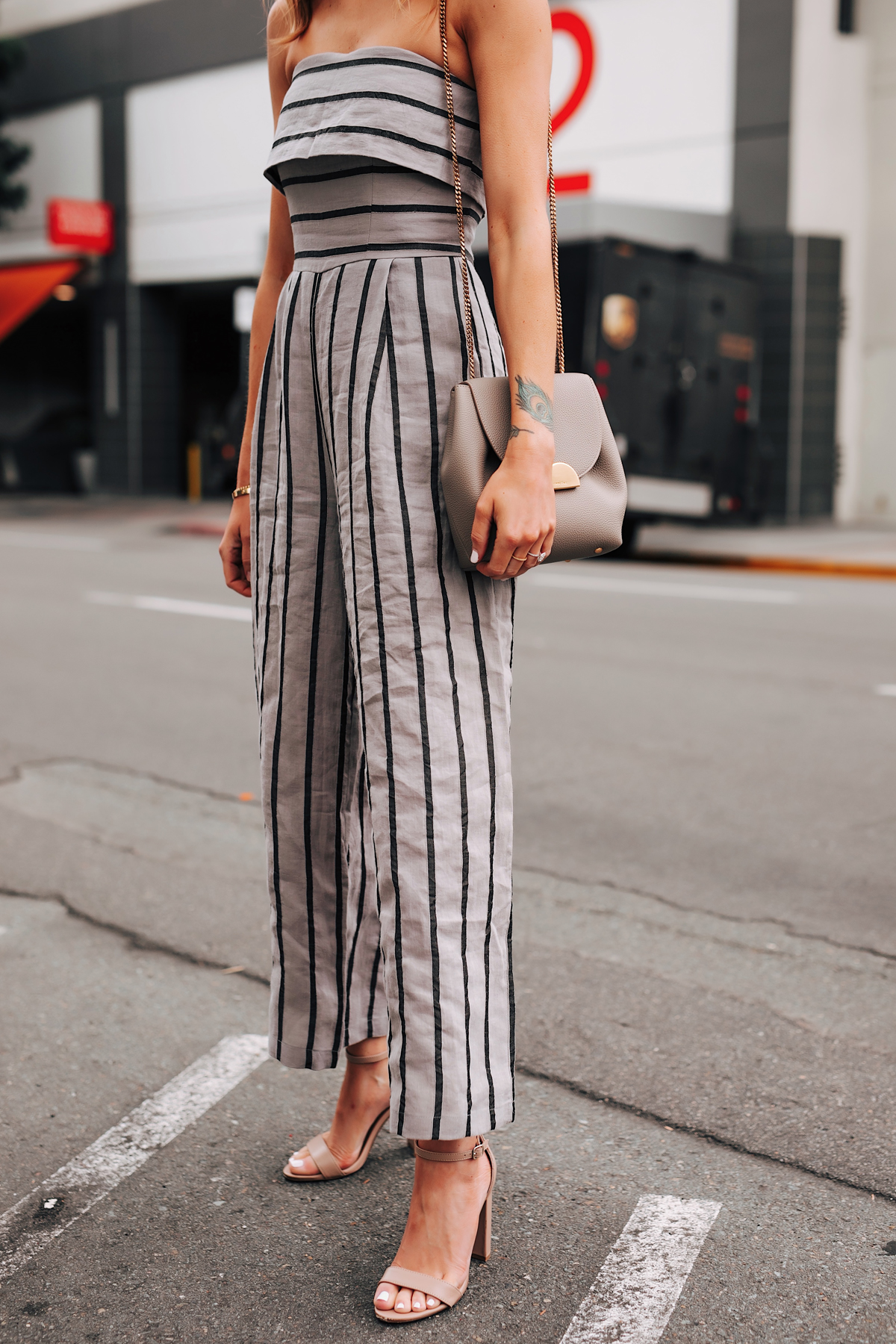 Woman Wearing Grey Strapless Stripe Jumpsuit Heeled Sandals Fashion Jackson San Diego Fashion Blogger Street Style