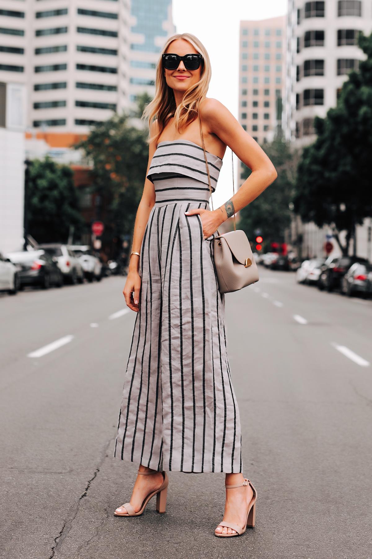 Blonde Woman Wearing Jing Grey Strapless Stripe Jumpsuit Heeled Sandals Grey Shoulder Handbag Fashion Jackson San Diego Fashion Blogger Street Style