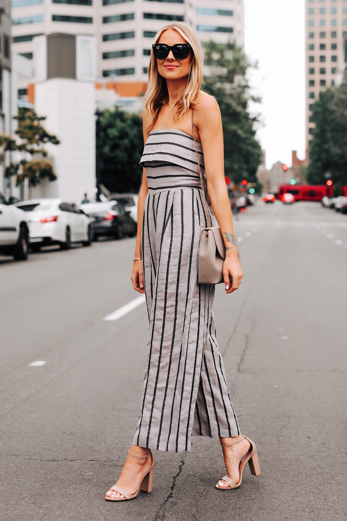 Blonde Woman Wearing Jing Grey Strapless Stripe Jumpsuit Heeled Sandals Fashion Jackson San Diego Fashion Blogger Street Style